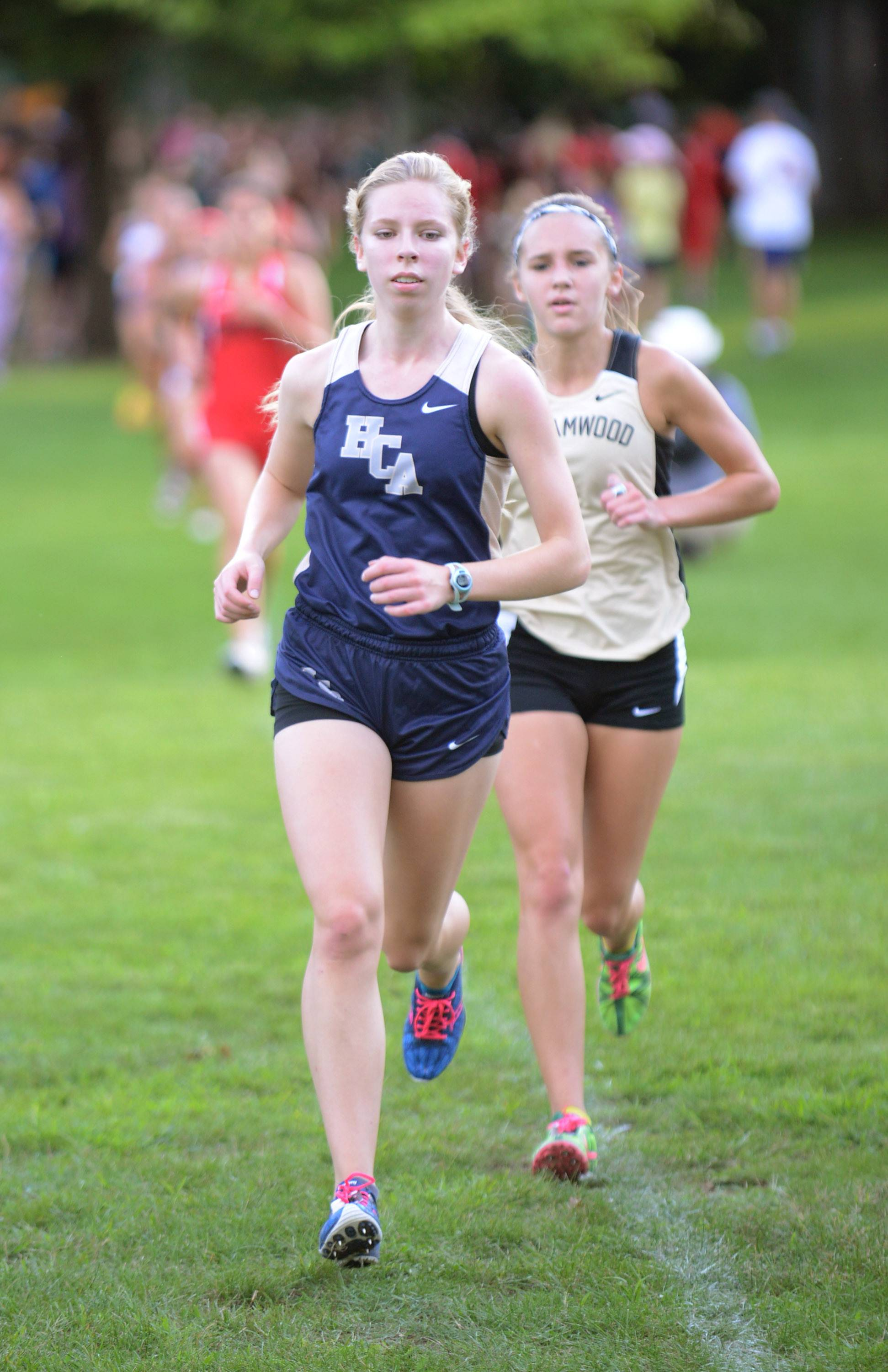 Harvest Christian Academy's Valerie Richter would cross first for her varsity team at the Elgin Invite cross country meet at Lords Park in Elgin on Tuesday.