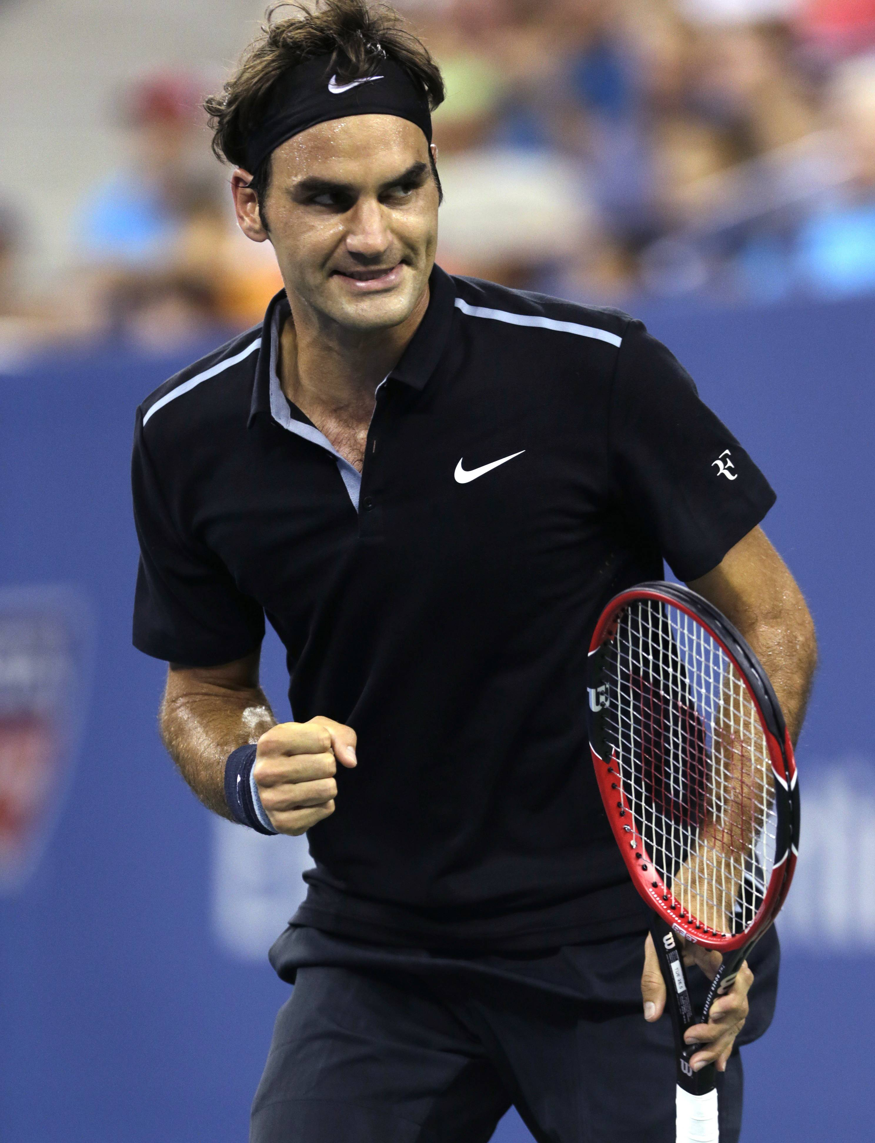 Roger Federer, of Switzerland, pumps his fist after winning the second set against Roberto Bautista Agut, of Spain, during the fourth round of the 2014 U.S. Open tennis tournament, Tuesday, Sept. 2, 2014, in New York.