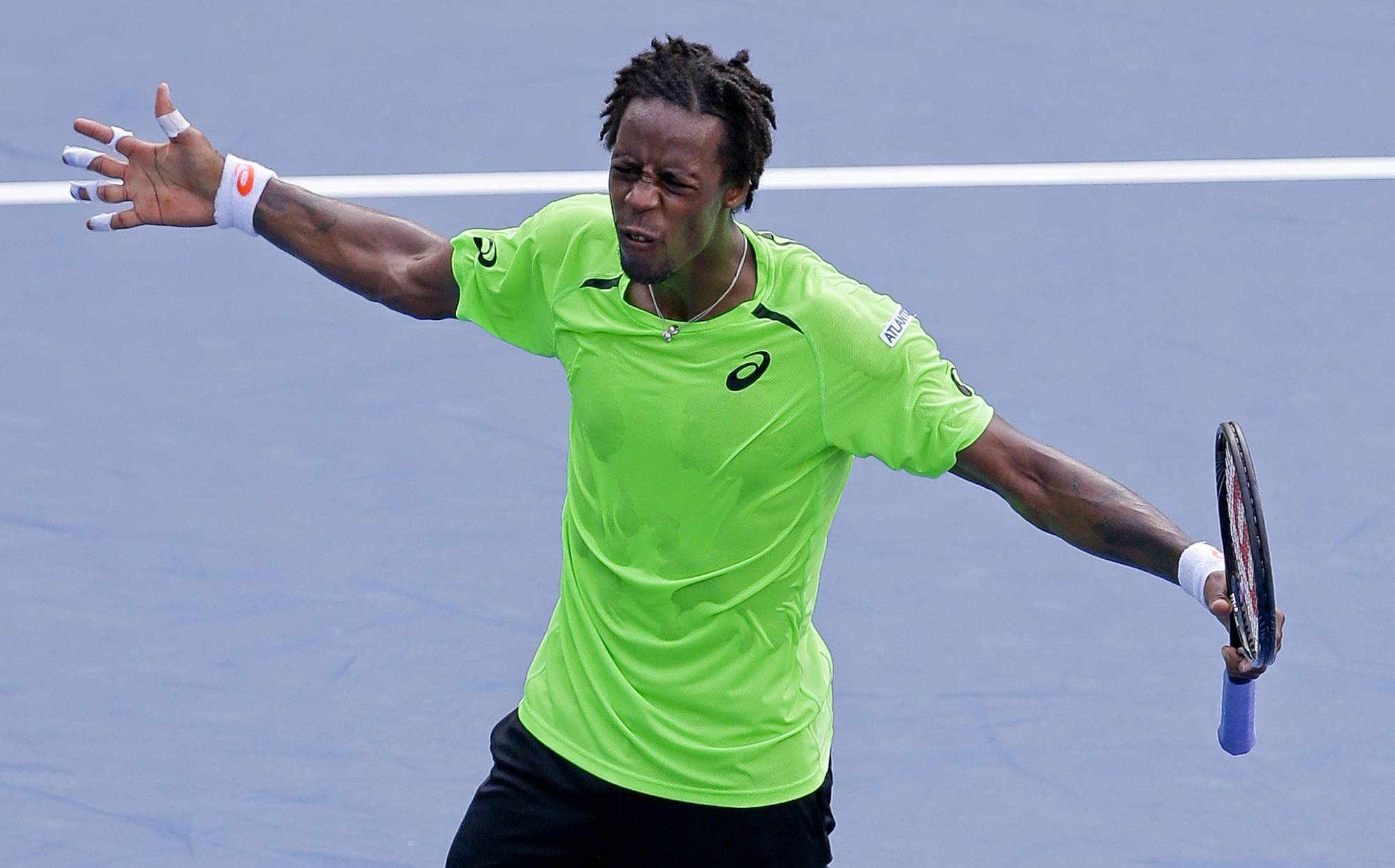 Gael Monfils, of France, reacts after defeating Grigor Dimitrov, of Bulgaria, during the fourth round of the 2014 U.S. Open tennis tournament, Tuesday, Sept. 2, 2014, in New York.