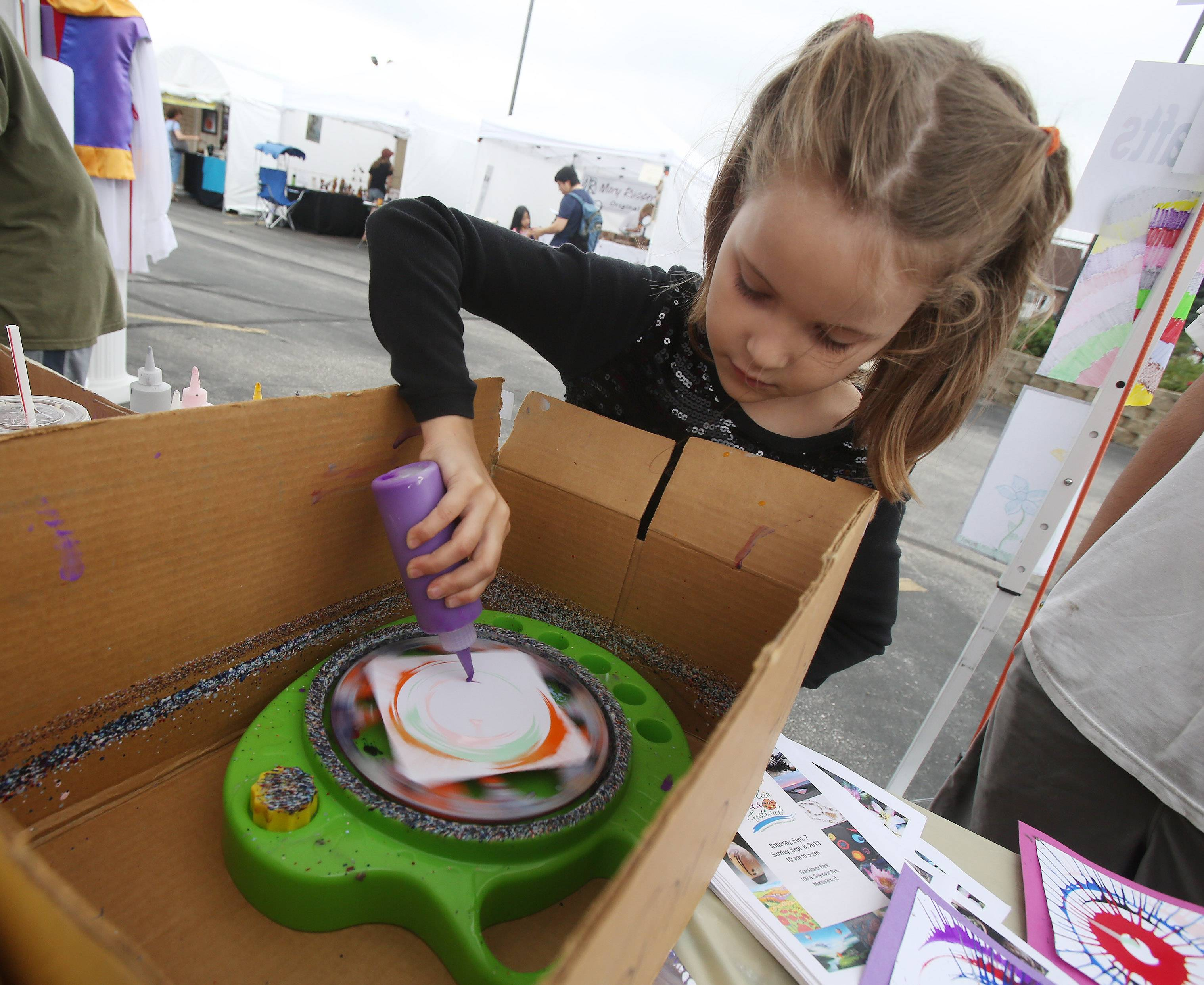 Blanca Lazar creates spin art during last year's Mundelein Arts Festival. This year's event will take place from 10 a.m. to 3 p.m. Saturday and Sunday, Sept. 6 and 7, in Kracklauer Park.