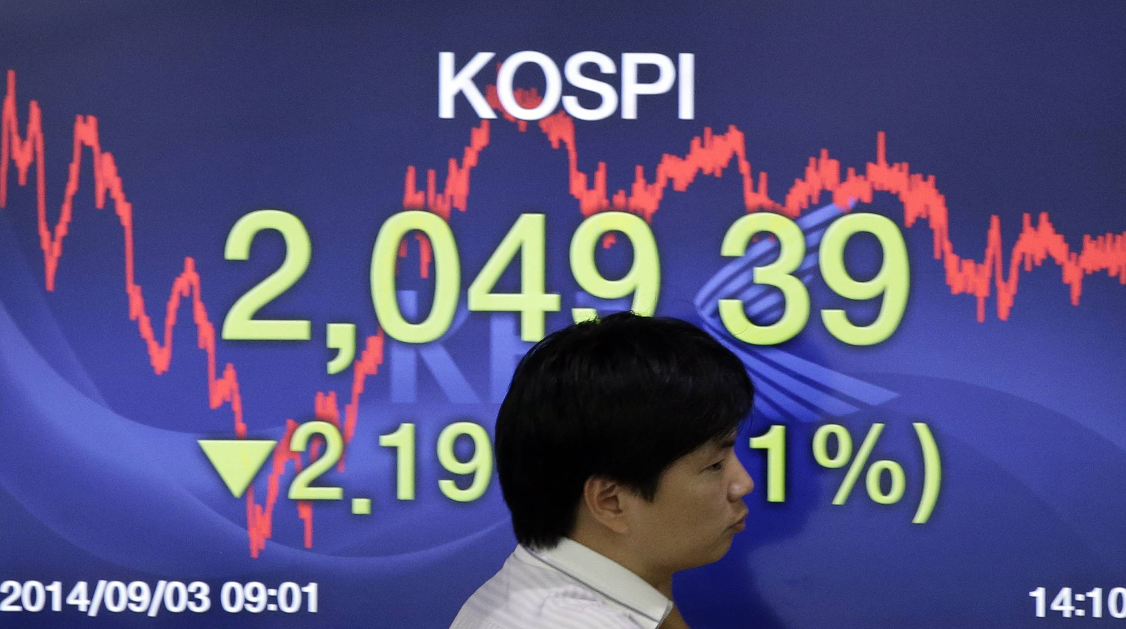 Asian stock markets rose Wednesday, lifted by new signs of strength in the U.S. economy and expectations that Europe's central bank will provide more support to the flagging region. Seen here is a screen showing the Korea Composite Stock Price Index at the Korea Exchange Bank headquarters in Seoul, South Korea, Wednesday.