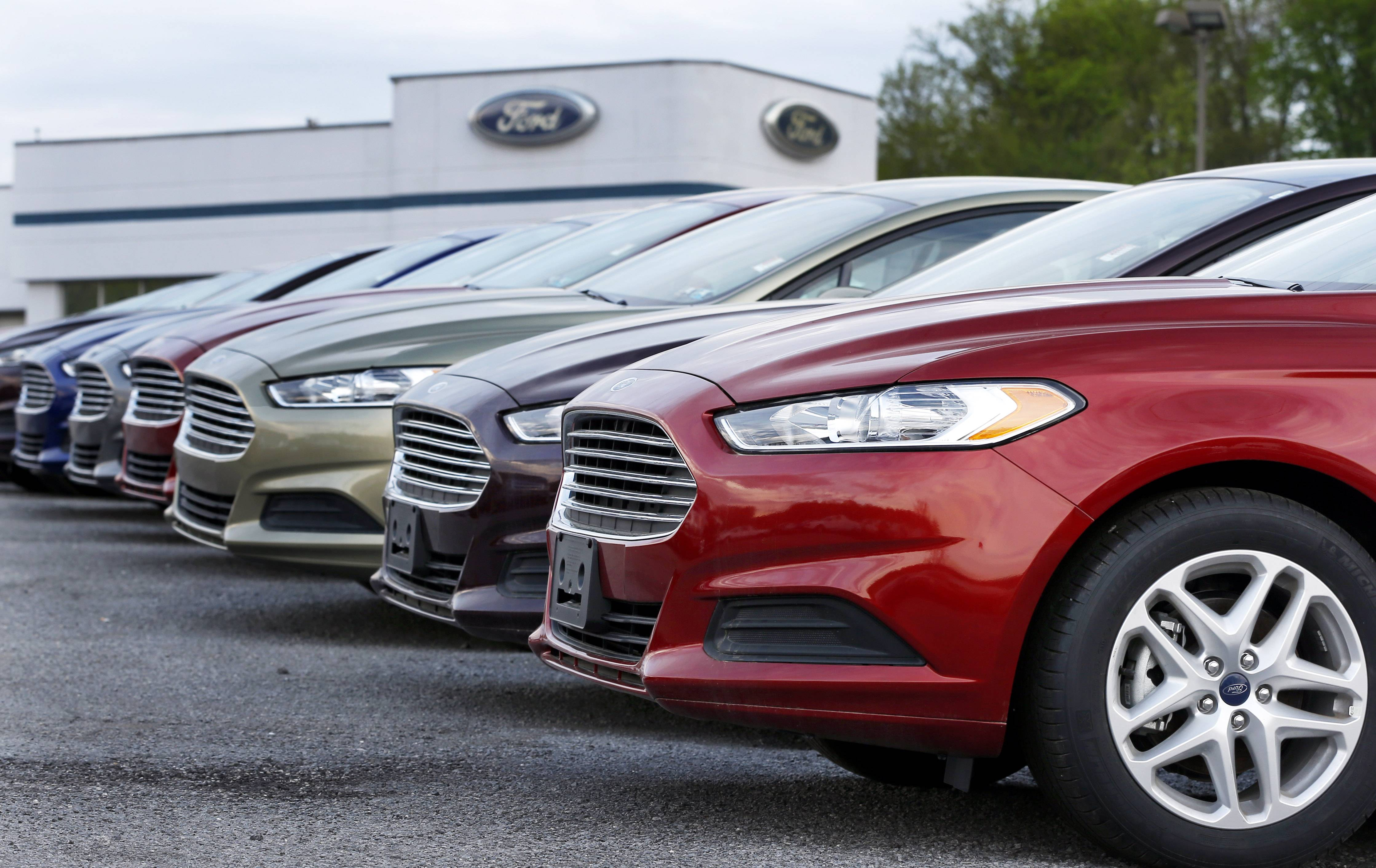 A row of new 2013 Ford Fusions are on display at an automobile dealership in Zelienople, Pa. Chrysler Group LLC reported its best August for U.S. vehicle deliveries in 12 years, while Ford Motor Co., Toyota Motor Corp., Honda Motor Co. and Nissan Motor Co. also posted results that surpassed analysts' projections.