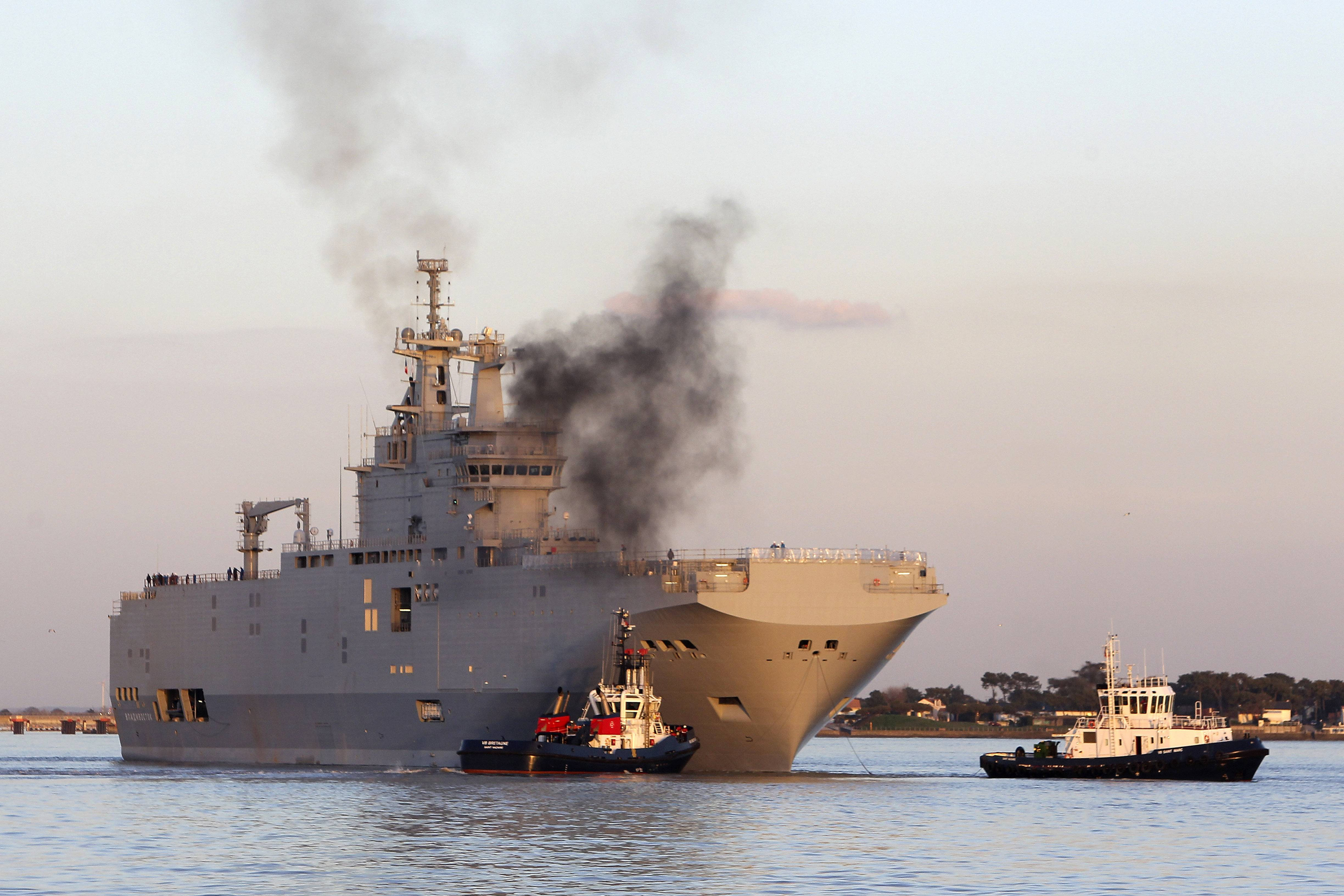 French-built warship BPC Vladivostock, designed to strengthen Russia's ability to deploy troops, tanks and helicopter gunships, leaves the Saint Nazaire's harbor, western France, for its test run on the open sea off coast of France. France is suspending the delivery of a hulking warship to Russia amid security concerns about Moscow's actions in neighboring Ukraine,
