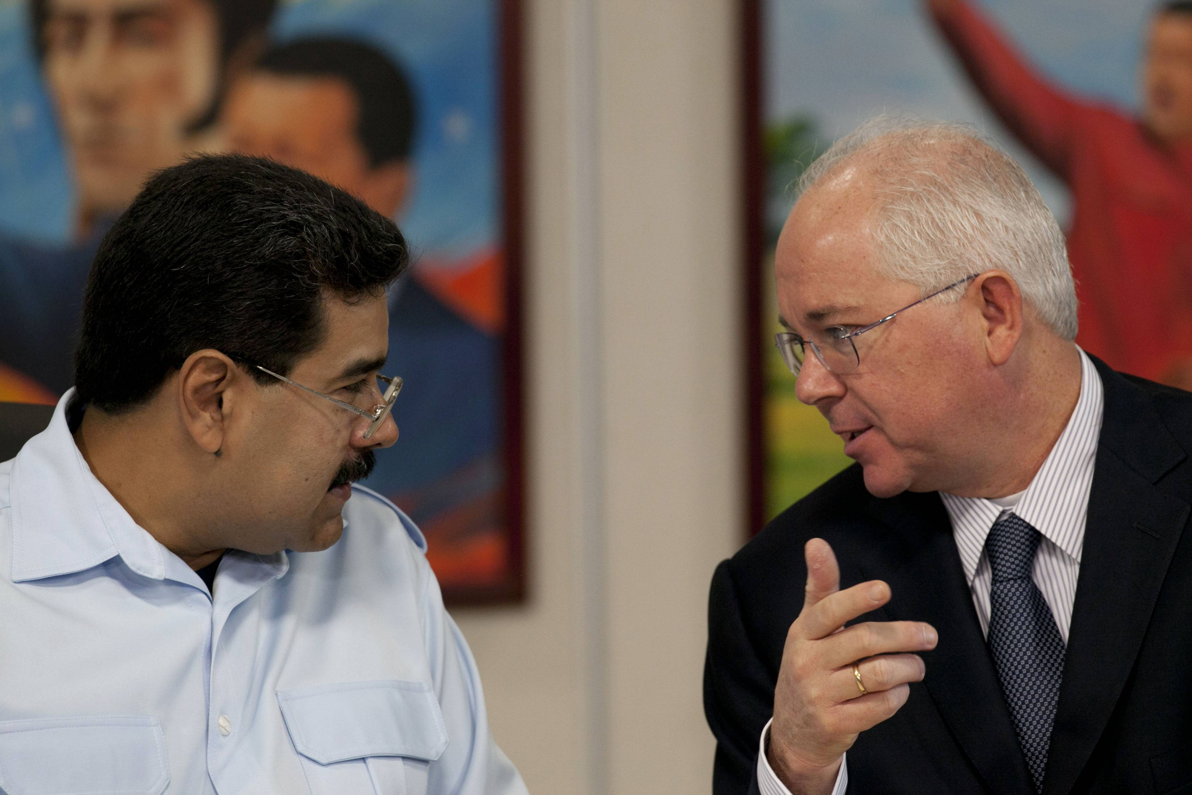 Venezuela President Nicholas Maduro (left) has replaced Oil Minister Rafael Ramirez.