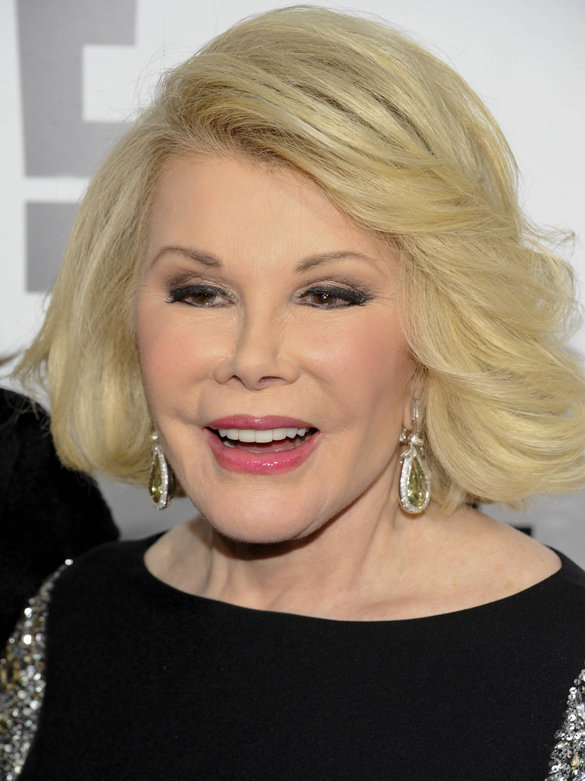 "Joan Rivers' family says she is ""being kept comfortable"" in the hospital."