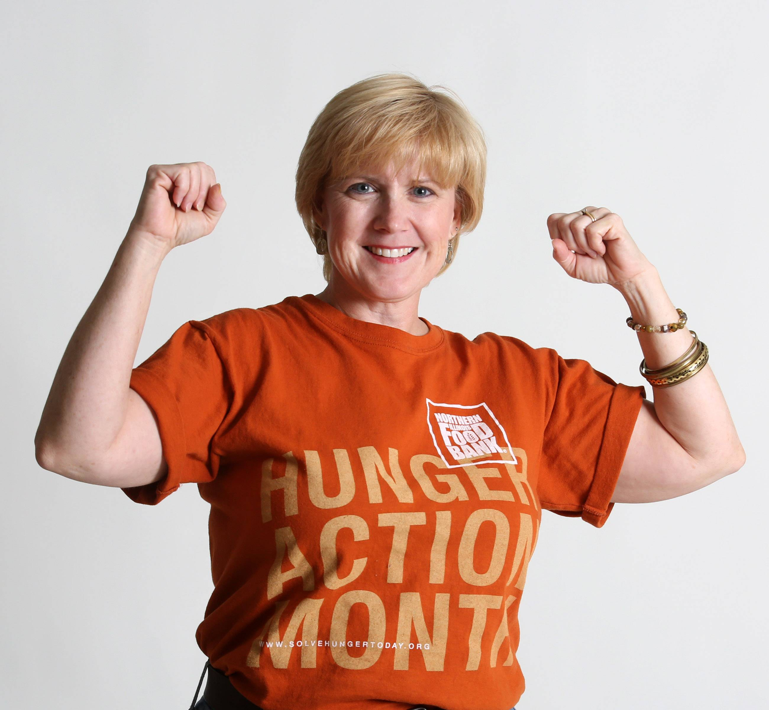 Food Editor Deborah Pankey wears orange to support Northern Illinois Food Bank's Hunger Action Day on Sept. 4.