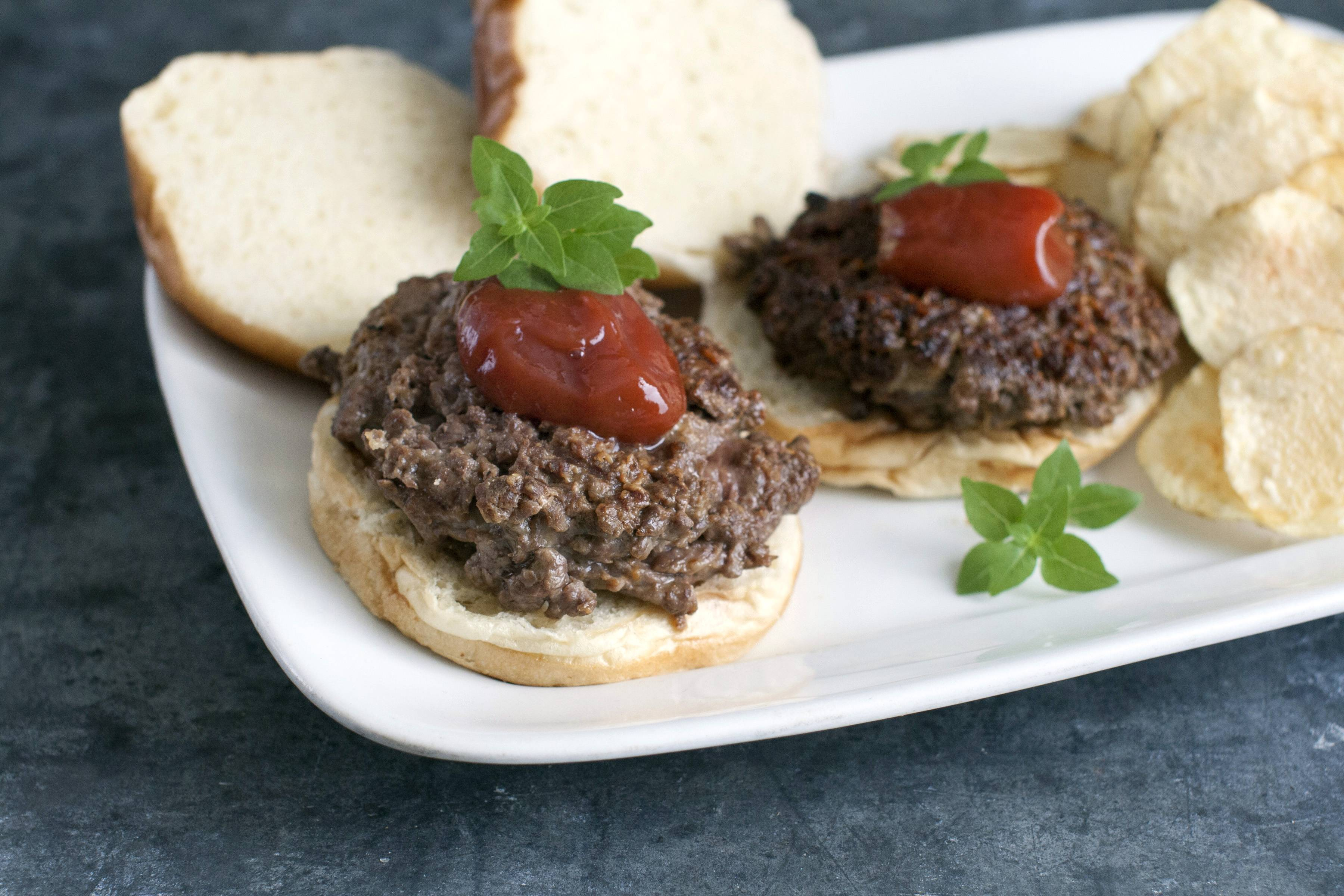 The trick to chopping the beef for your own burgers is to cut it into 1-inch chunks, then freeze it for about 15 minutes until it is just firm. These partially frozen chunks chop perfectly in the processor without becoming overworked.