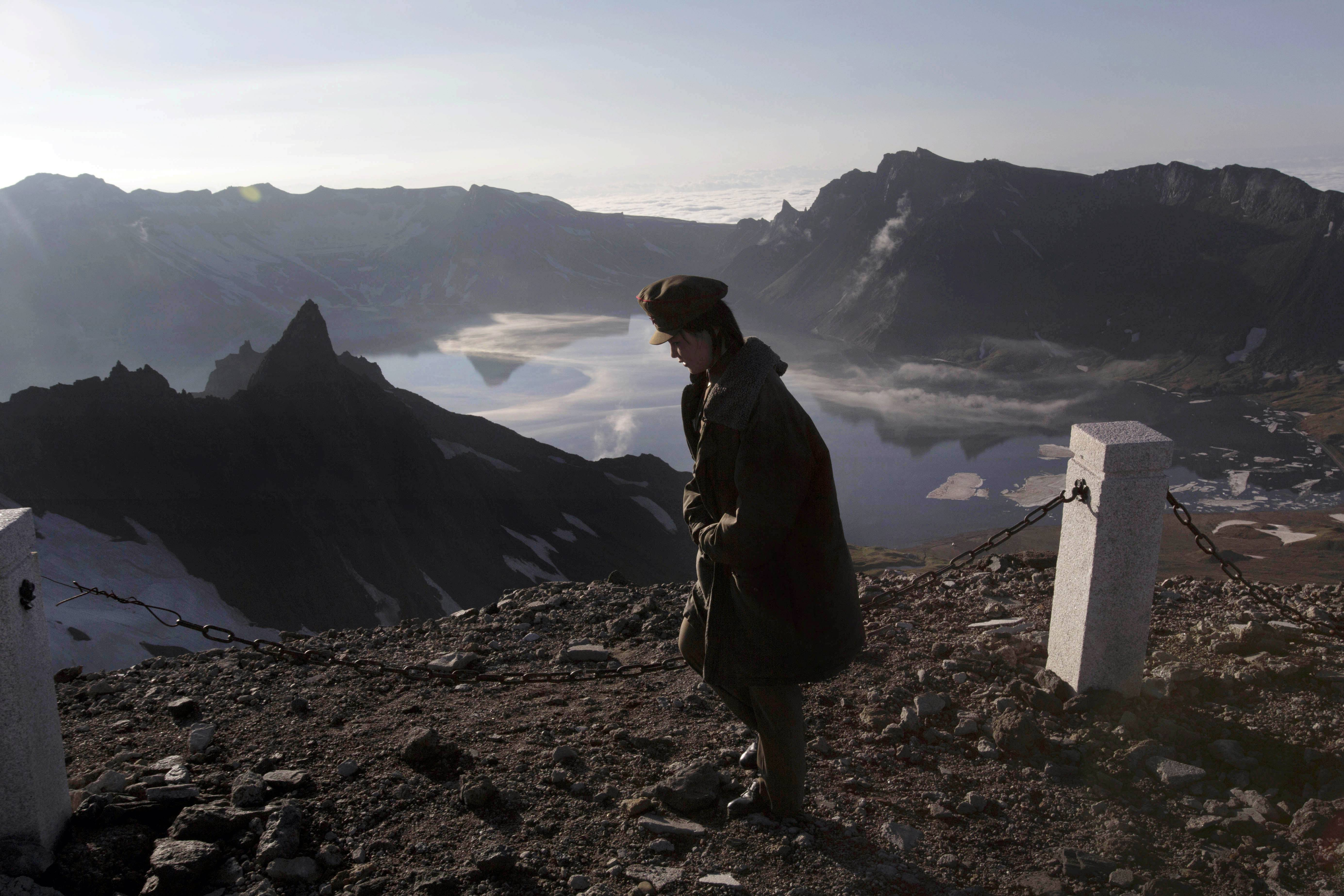 A North Korean woman walks on the peak of Mt. Paektu in North Korea's Ryanggang province. Unlike other major volcanos around the world, the remote and politically sensitive Mount Paektu remains almost a complete mystery to foreign scientists who have — until recently — been unable to conduct on-site studies.