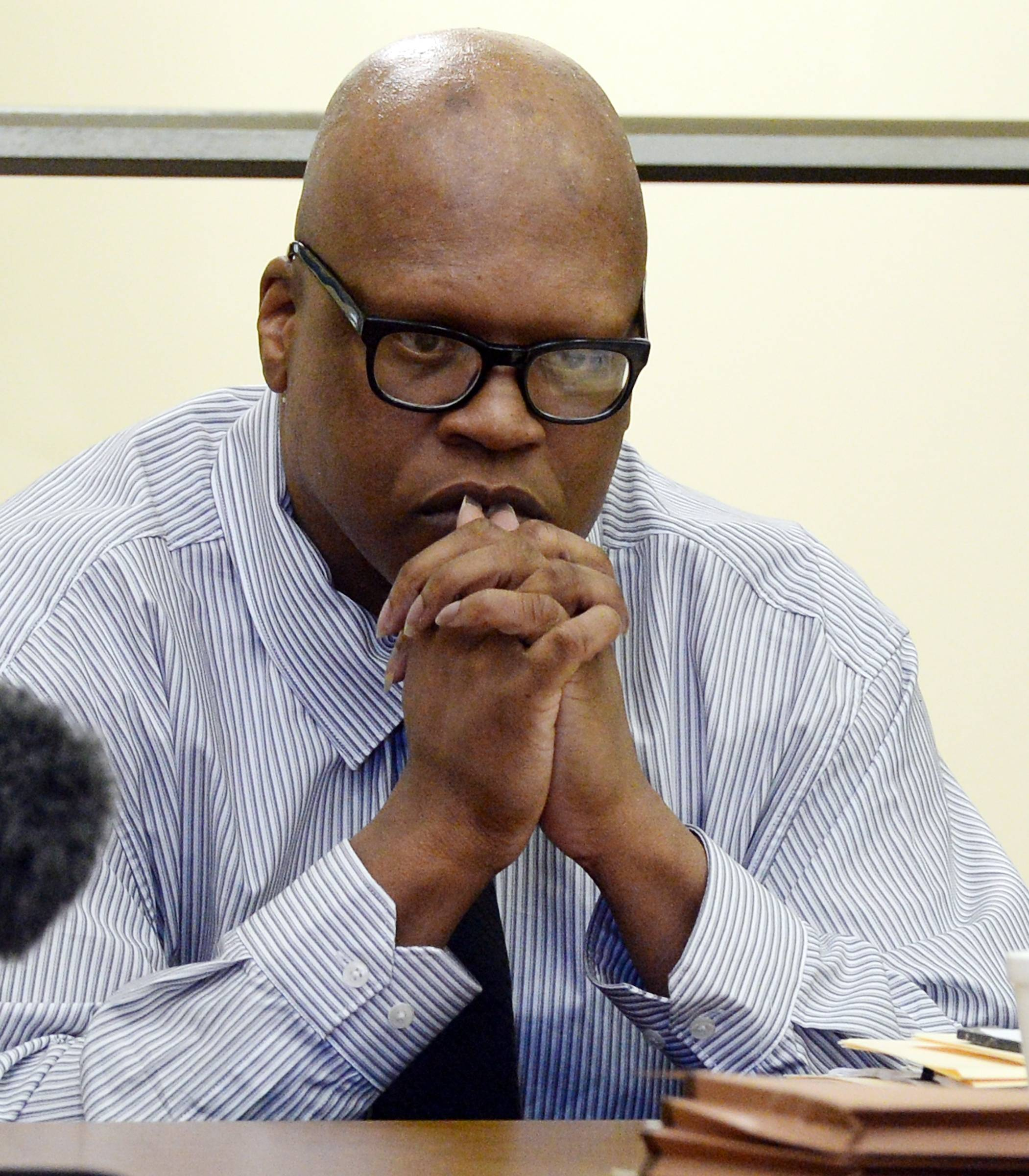 Leon Brown listens to evidence during a court hearing for him and his brother, death row inmate Henry McCollum Tuesday, Sept. 2, 2014 in Lumberton, N.C. On Tuesday, a judge overturned the convictions of Henry McCollum, 50, and Leon Brown, 46, in the 1983 rape and murder of the 11-year-old girl, citing the new evidence that they are innocent.