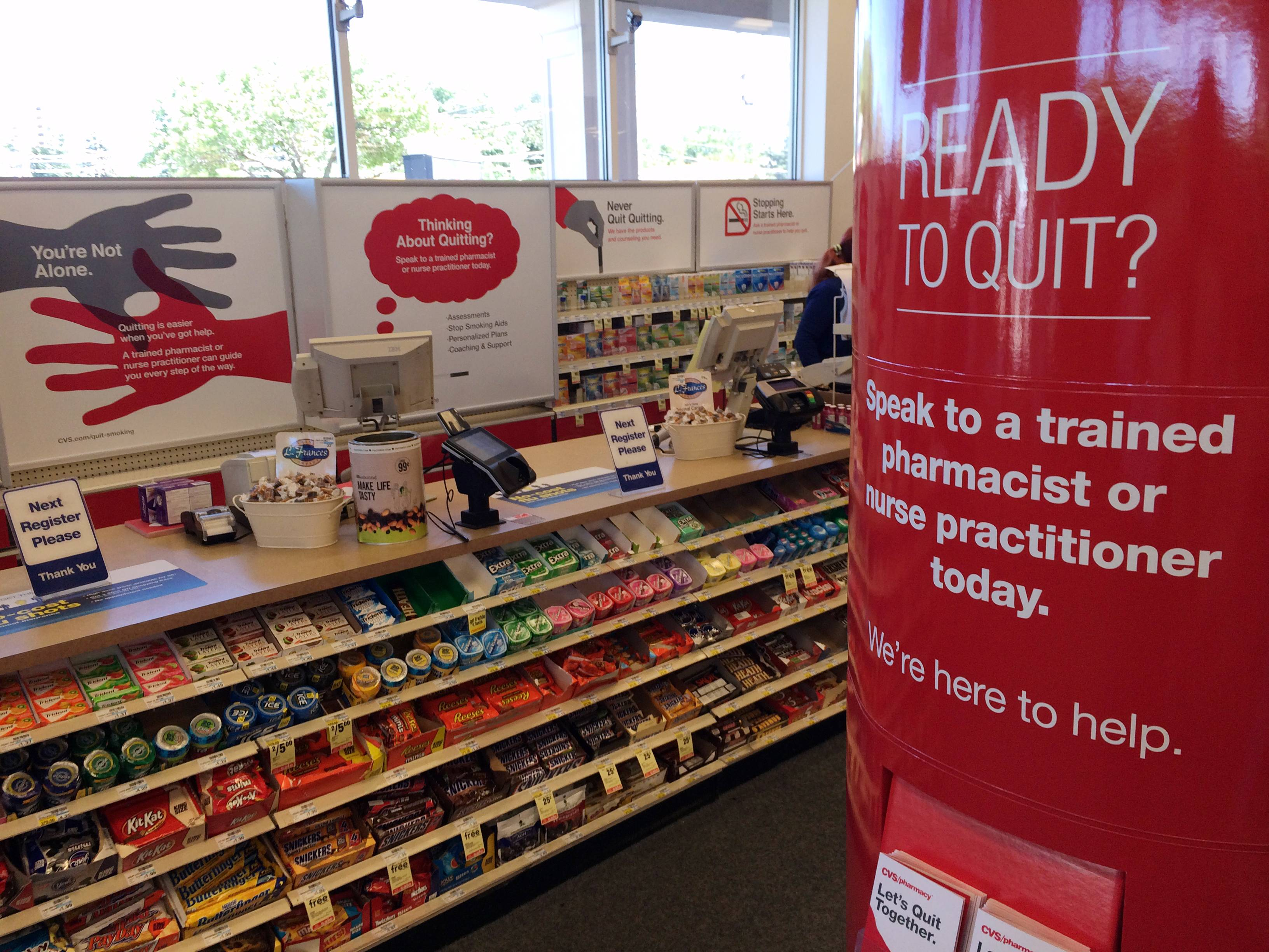 Signs encouraging people to quit smoking replace cigarette displays at a CVS pharmacy in Mount Prospect.