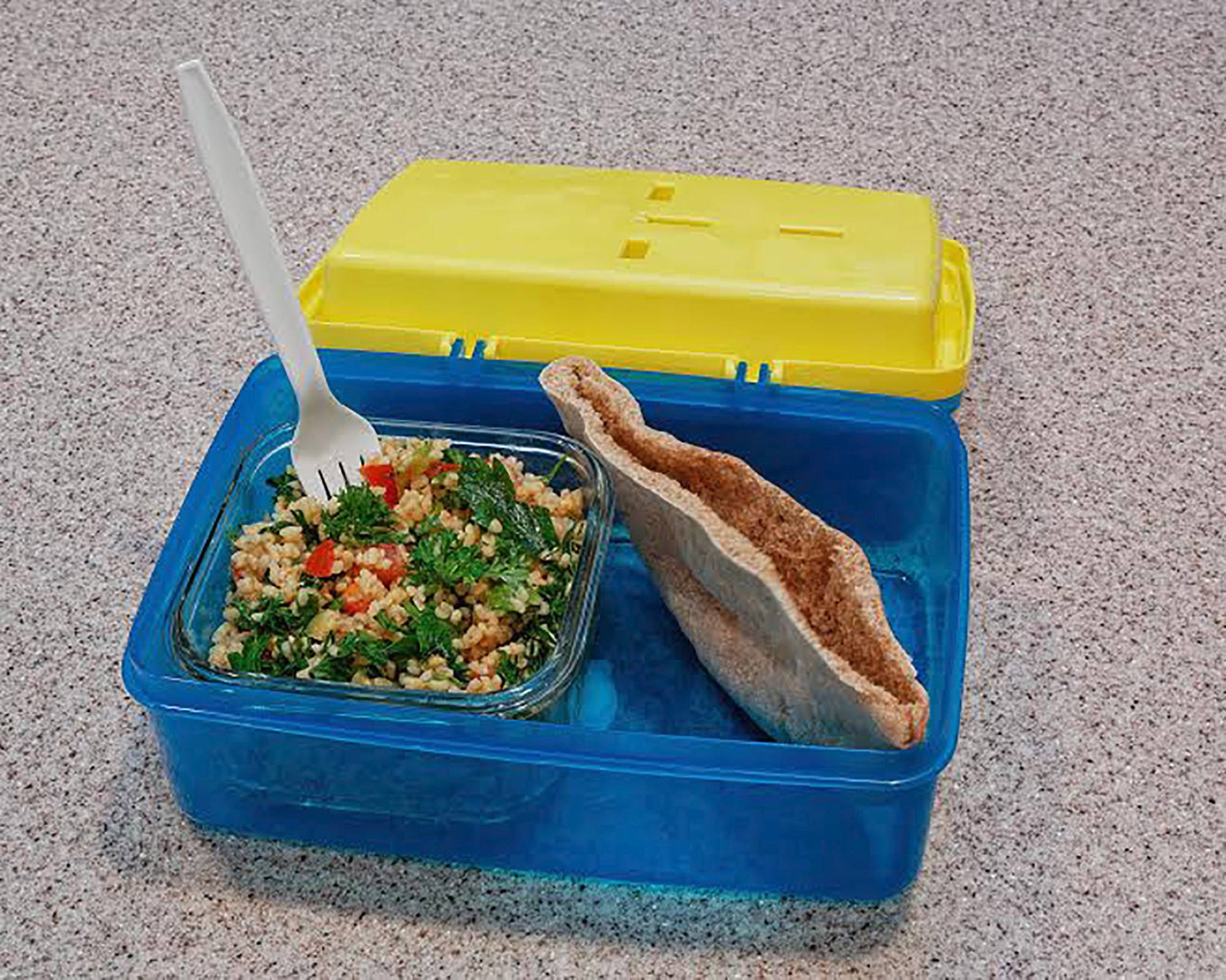 Courtesy of Christine PalumboA compartmentalized lunch box featuring a tabbouleh salad and whole wheat pita bread.