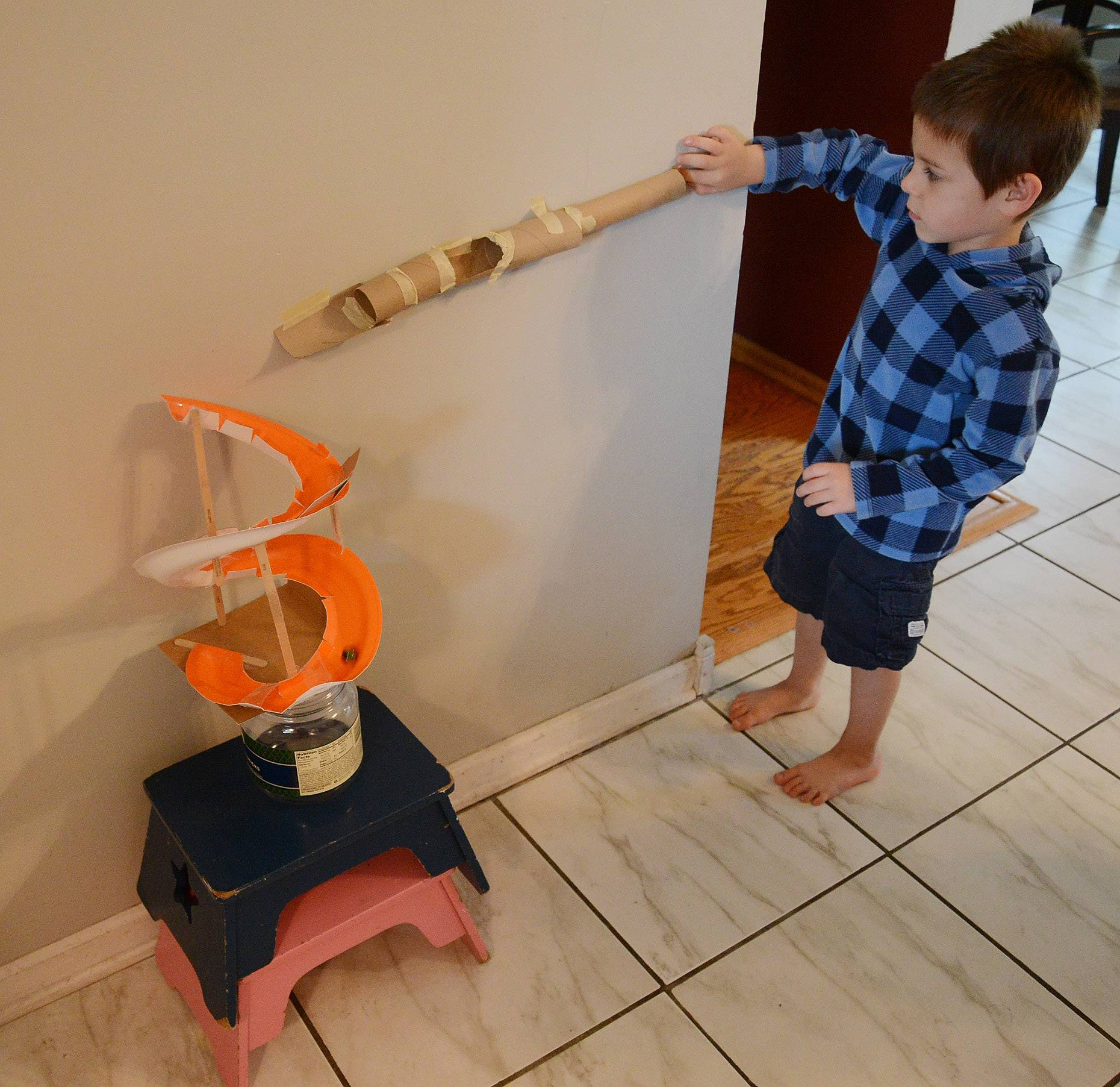 Justin Anderson demonstrates his marble run.