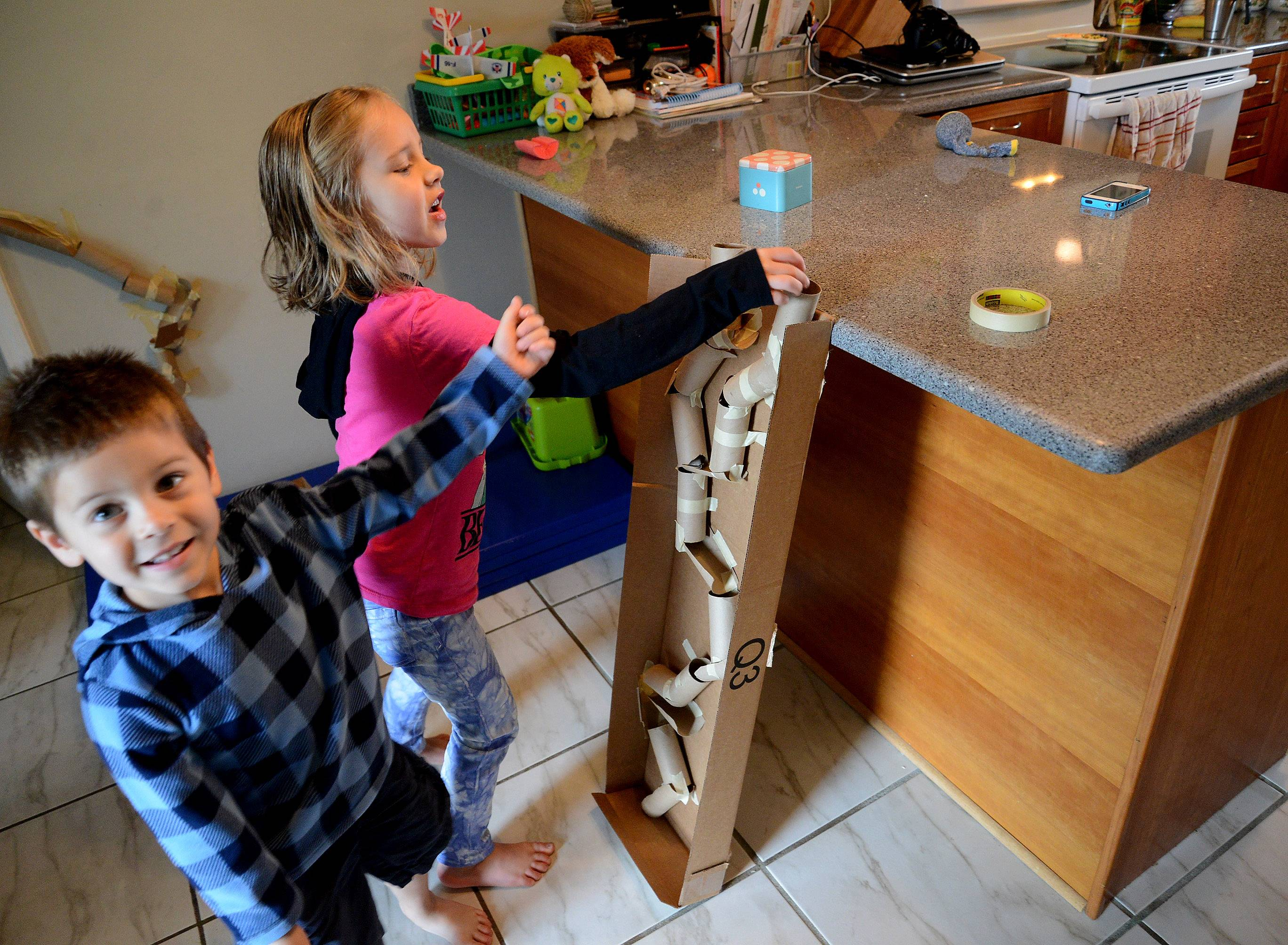 Justin and Lily Anderson demonstrate their marble runs.
