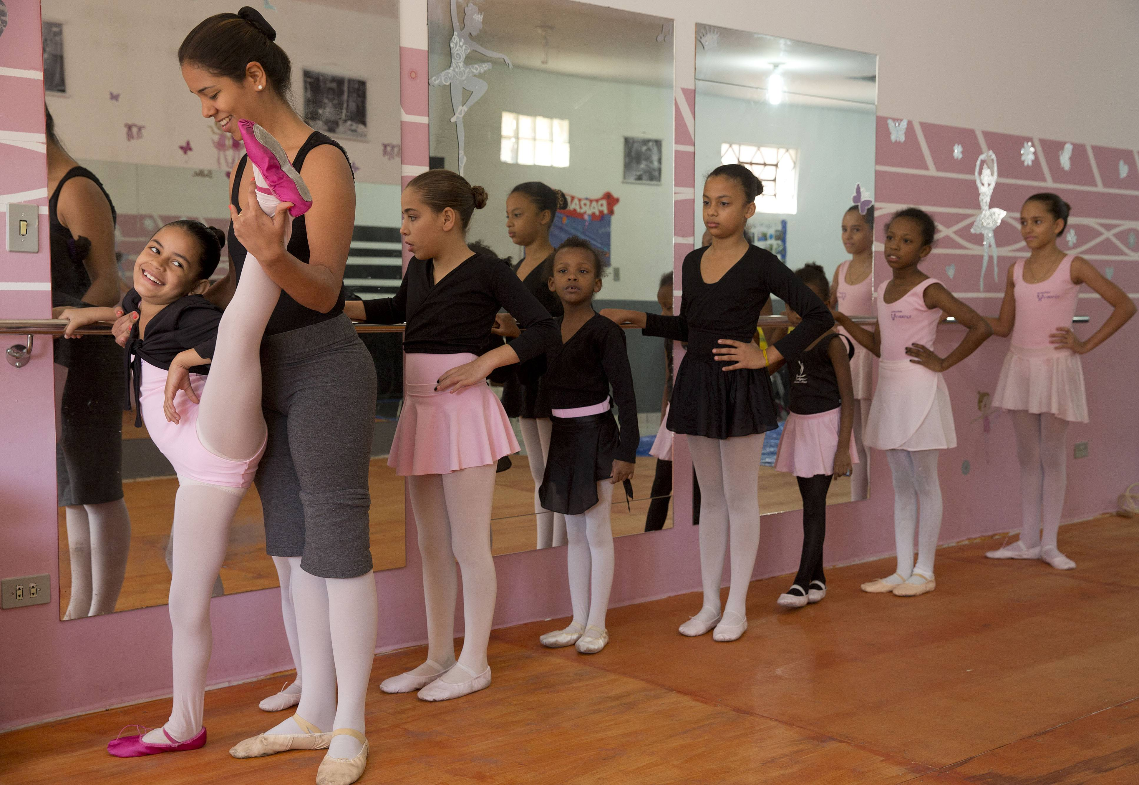 "Ballet instructor Joana Machado instructs young girls at her House of Dreams dance studio in Crackland, one of the roughest neighborhoods of downtown Sao Paulo, Brazil. ""We see all kinds of stories here. From girls who haven't showered in days, who don't know how to brush their teeth, who are locked inside their homes all day,"" said Machado. ""I feel always responsible for their lives, always worried about what may happen."""