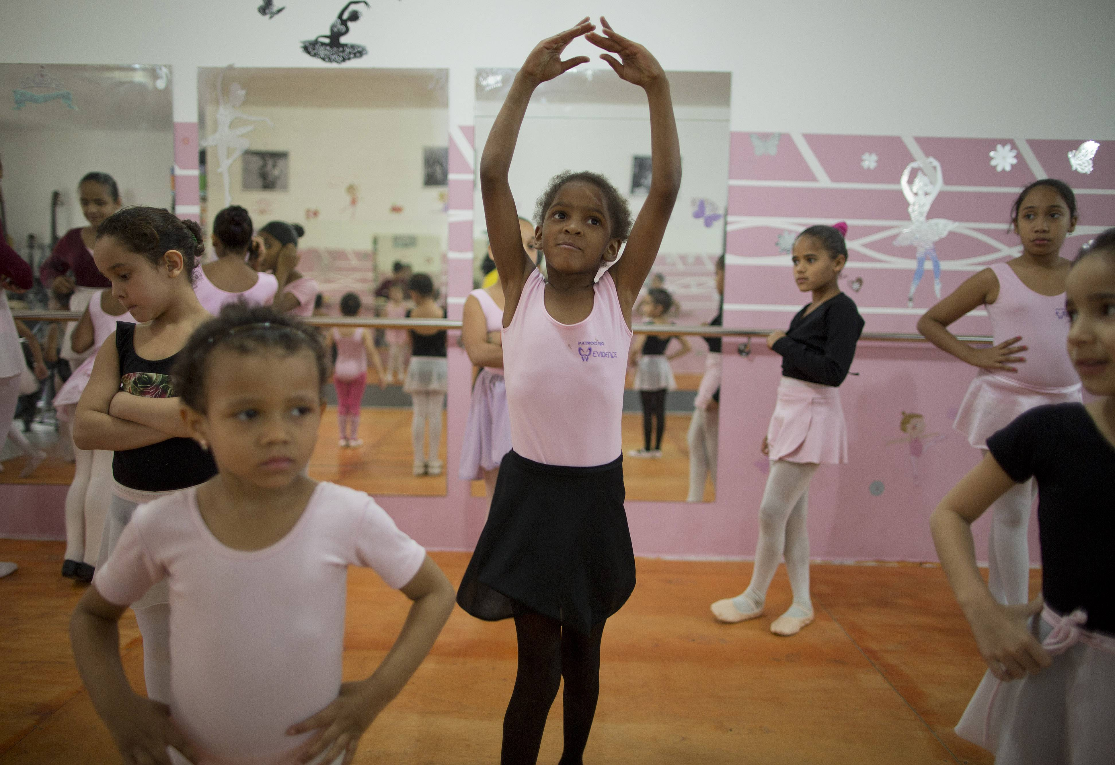 Girls participate in a ballet class at the House of Dreams dance studio in Crackland, one of the roughest neighborhoods in downtown Sao Paulo, Brazil. Growing up amid drug dealers and addicts, some girls have yet to learn how to read. Yet they are learning the graceful art of ballet courtesy of a local church group that also offers them food, counseling and Bible studies.