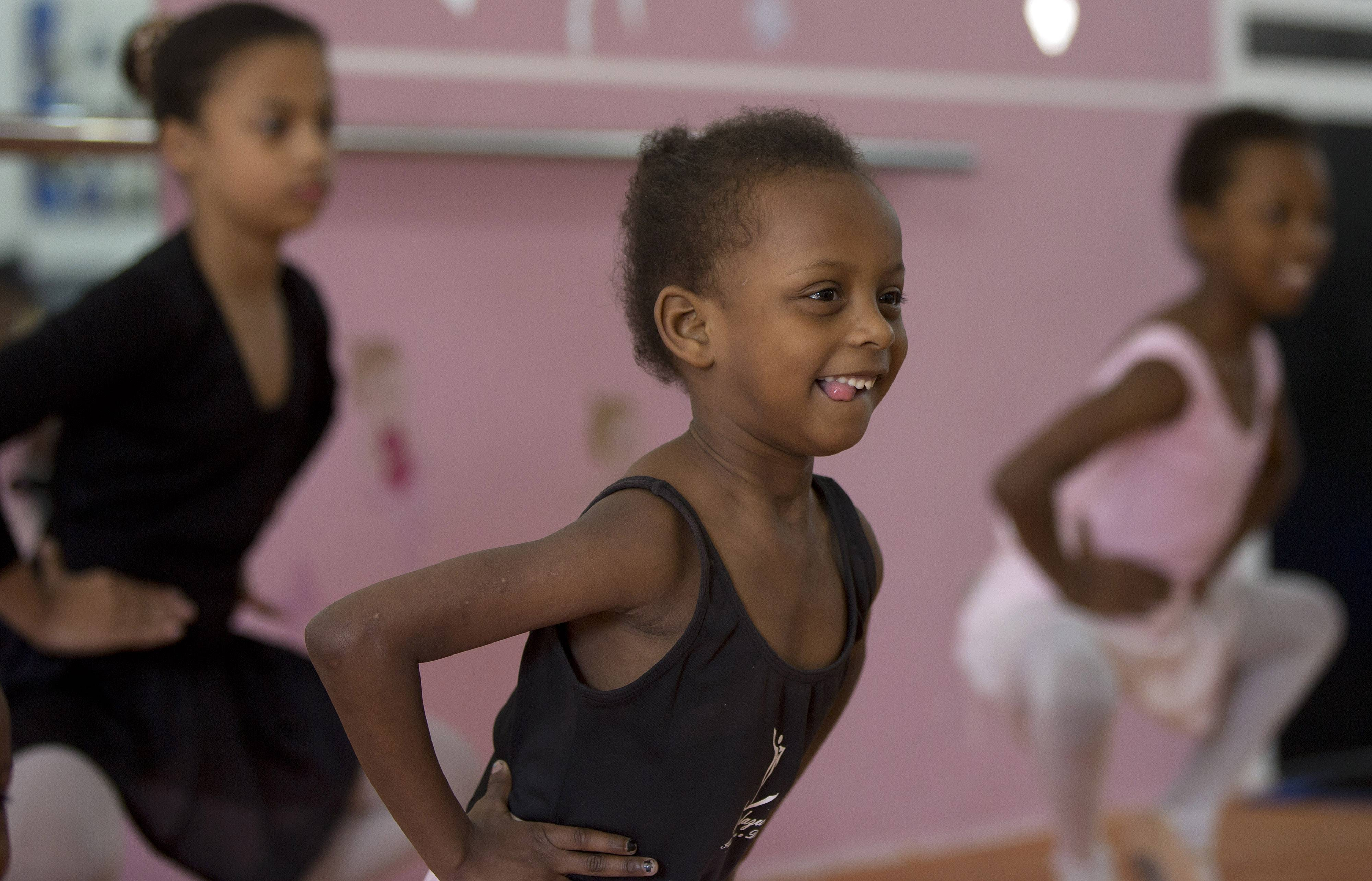Girls learn ballet at The House of Dreams dance studio in Crackland, one of the roughest neighborhoods of downtown Sao Paulo, Brazil. The young dancers hope to catch the eye of a respected Brazilian ballerina who recruits dozens of disadvantaged girls for an annual workshop.