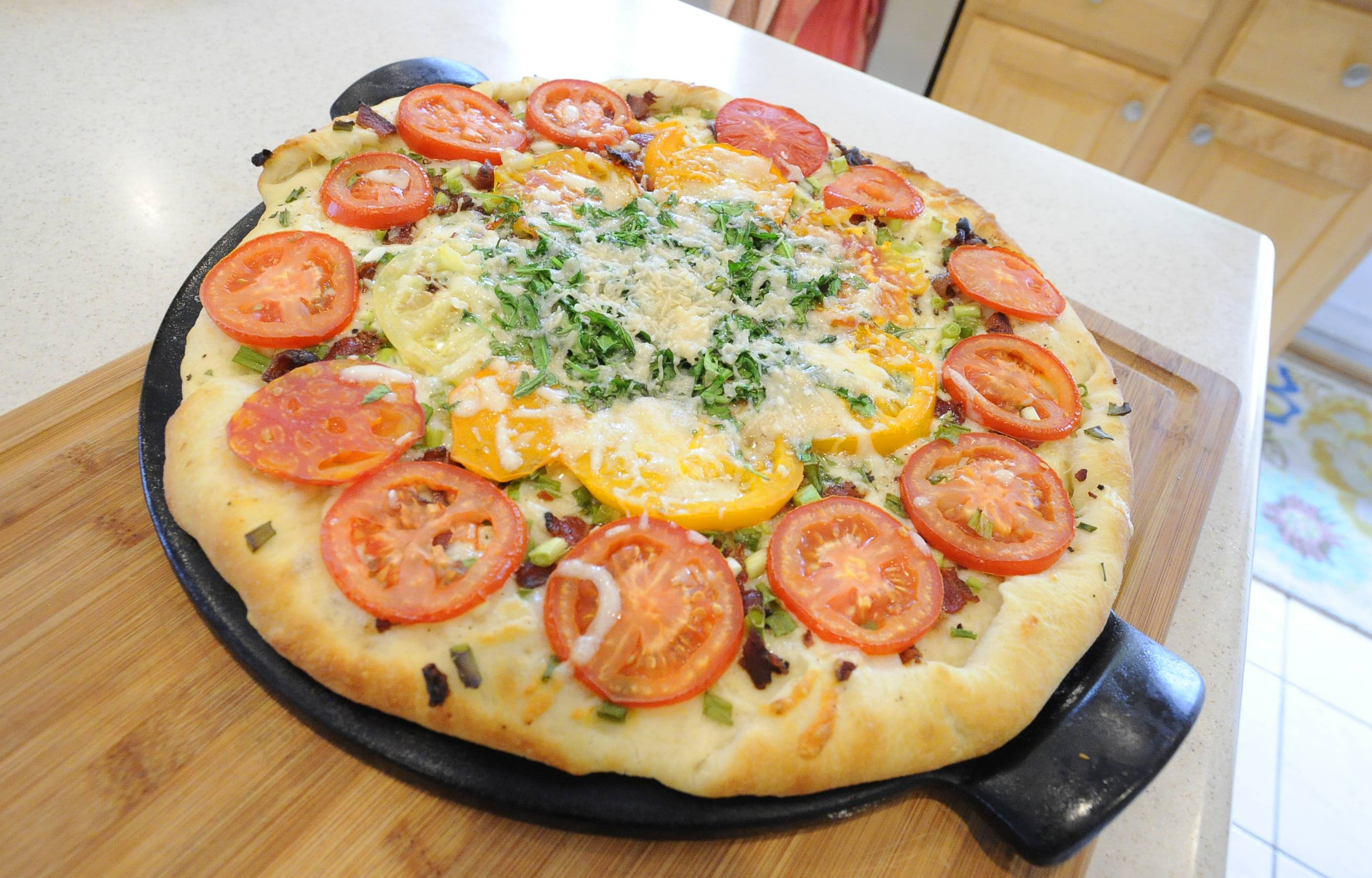 Tara Riley partnered tomatoes from Whole Foods Market with vegetables from her garden and Fontina cheese to make a BLT pizza.