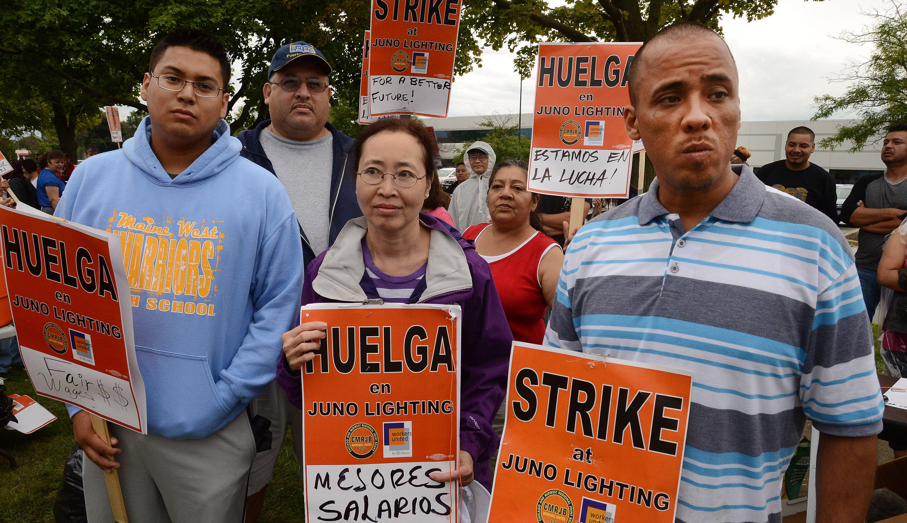 From left, Felipe Delgado, Des Plaines, Tuyet Huynh, Chicago, and Malaquias Gutierrez, Chicago, workers on strike outside Juno Lighting in Des Plaines.