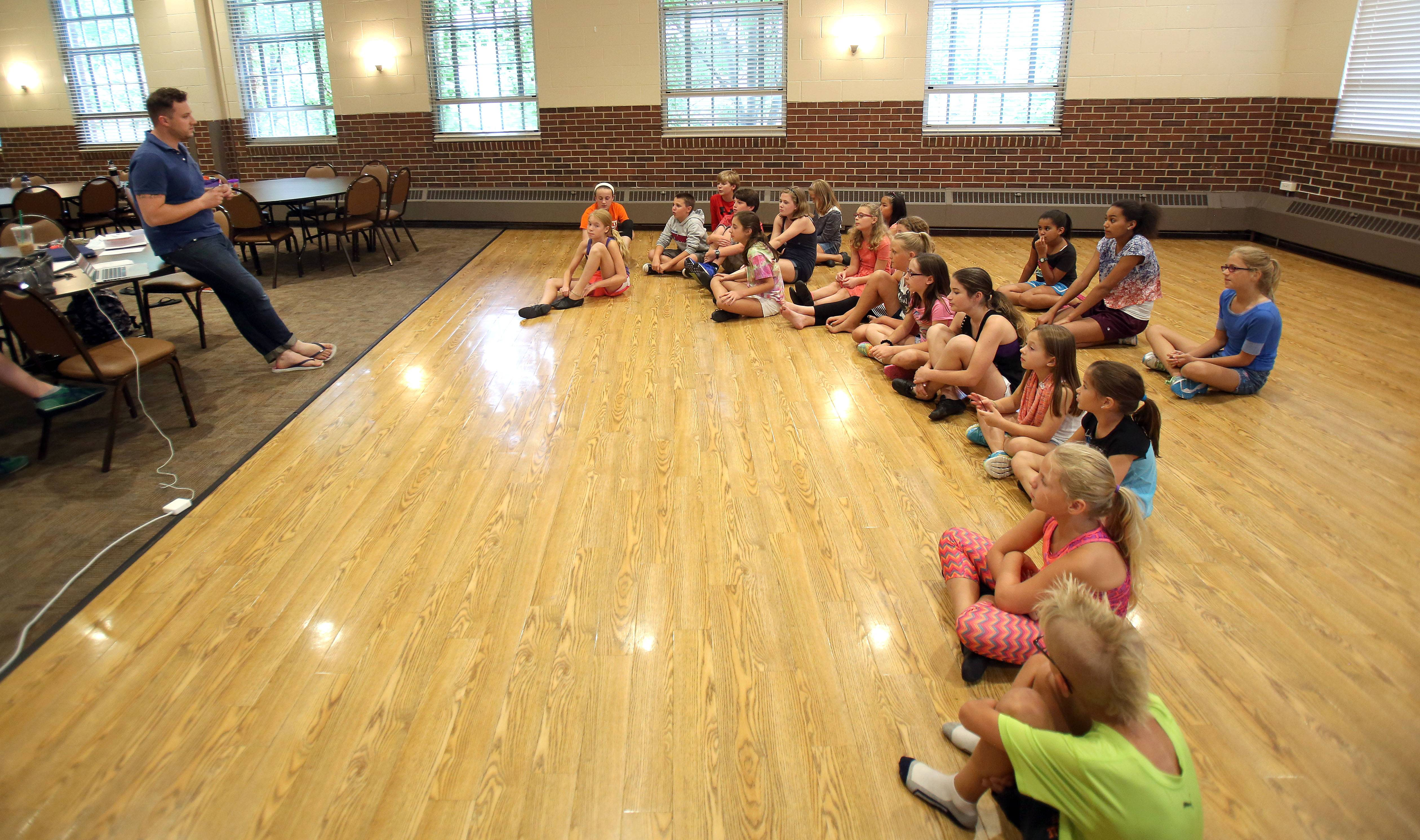Director Bill Stilton talks to kids during an audition at Libertyville Civic Center.