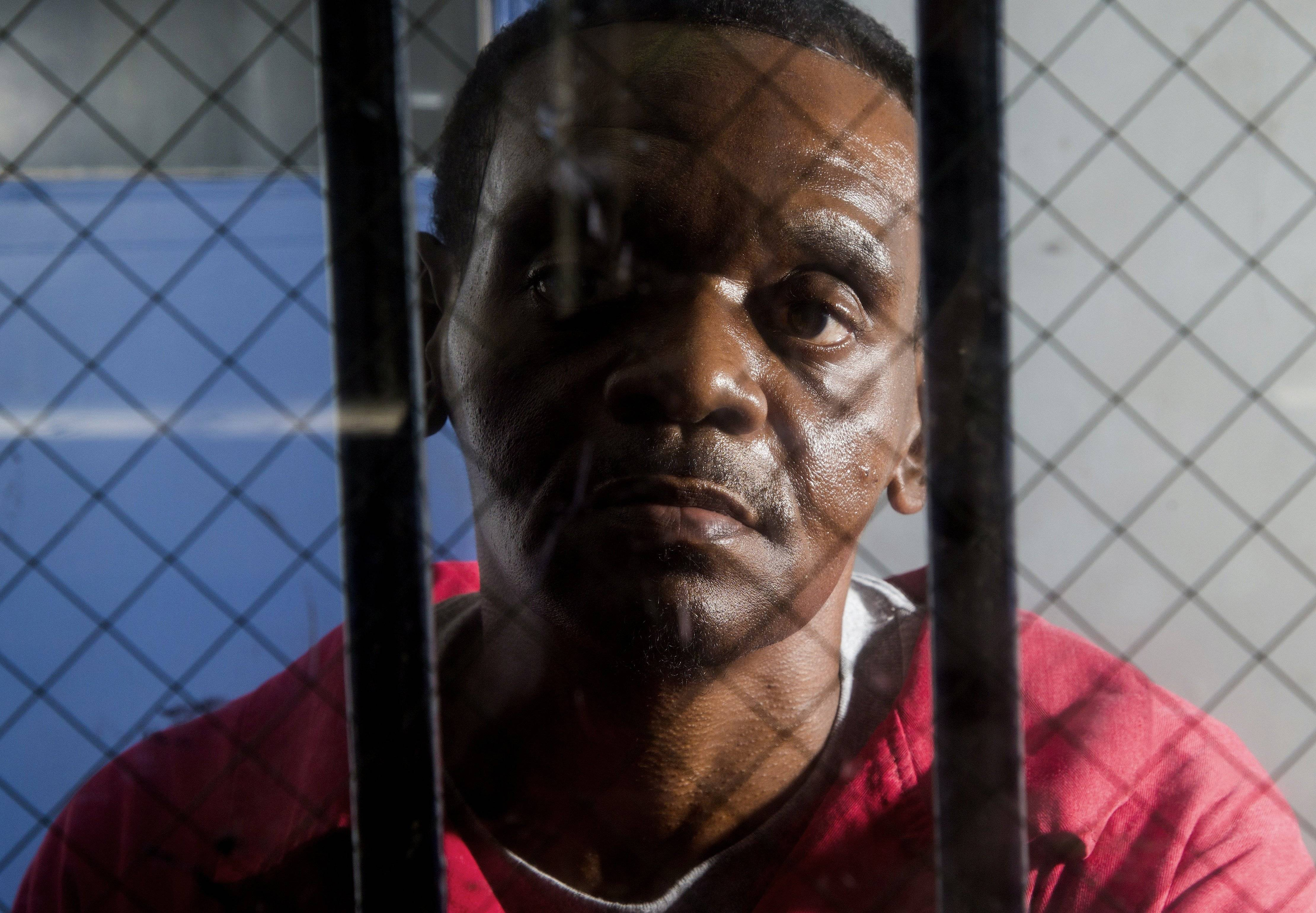 Henry McCollum sits and his half brother Leon Brown have spent more than three decades in prison for the rape and murder of 11-year-old Sabrina Buie in 1983. McCollum was freed from prison Wednesday, a day after a judge overturned his conviction because of new DNA evidence in the case.