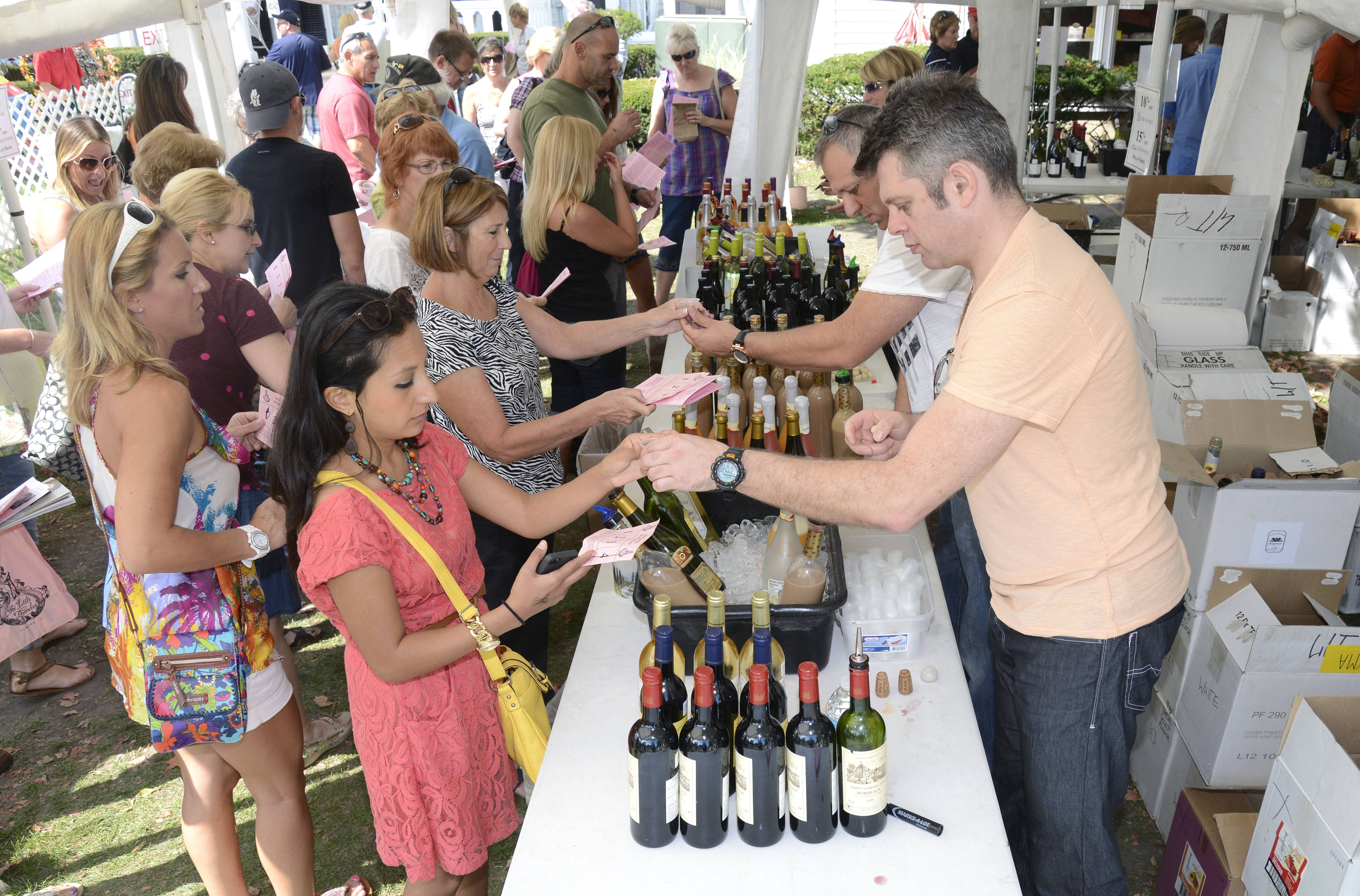 Visitors line up for wine tasting at last year's Festival of the Vine in downtown Geneva.