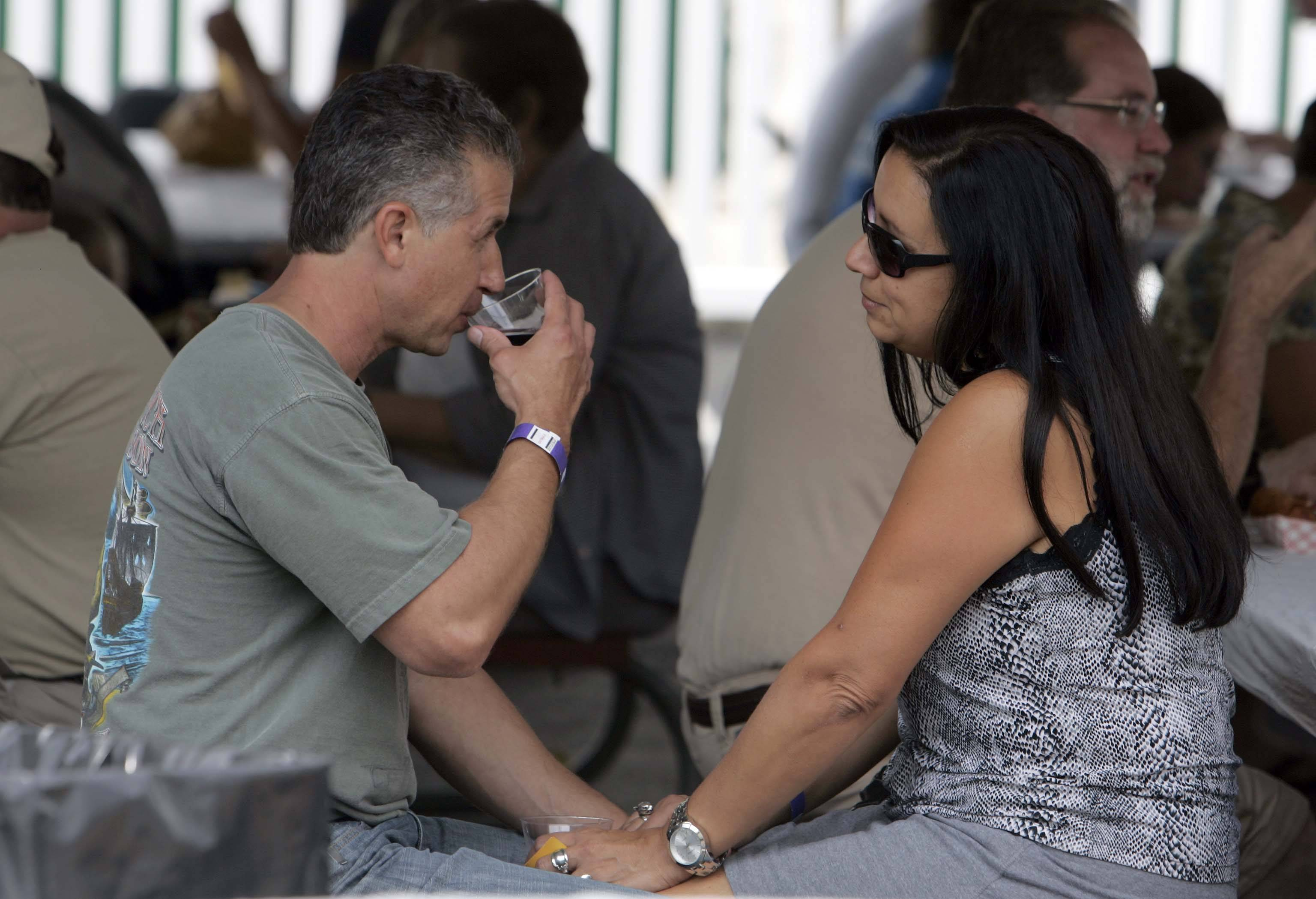Angelo and Doris Sorce of Elmhurst enjoy a quiet moment while having a glass of wine at a previous Festival of the Vine in Geneva.