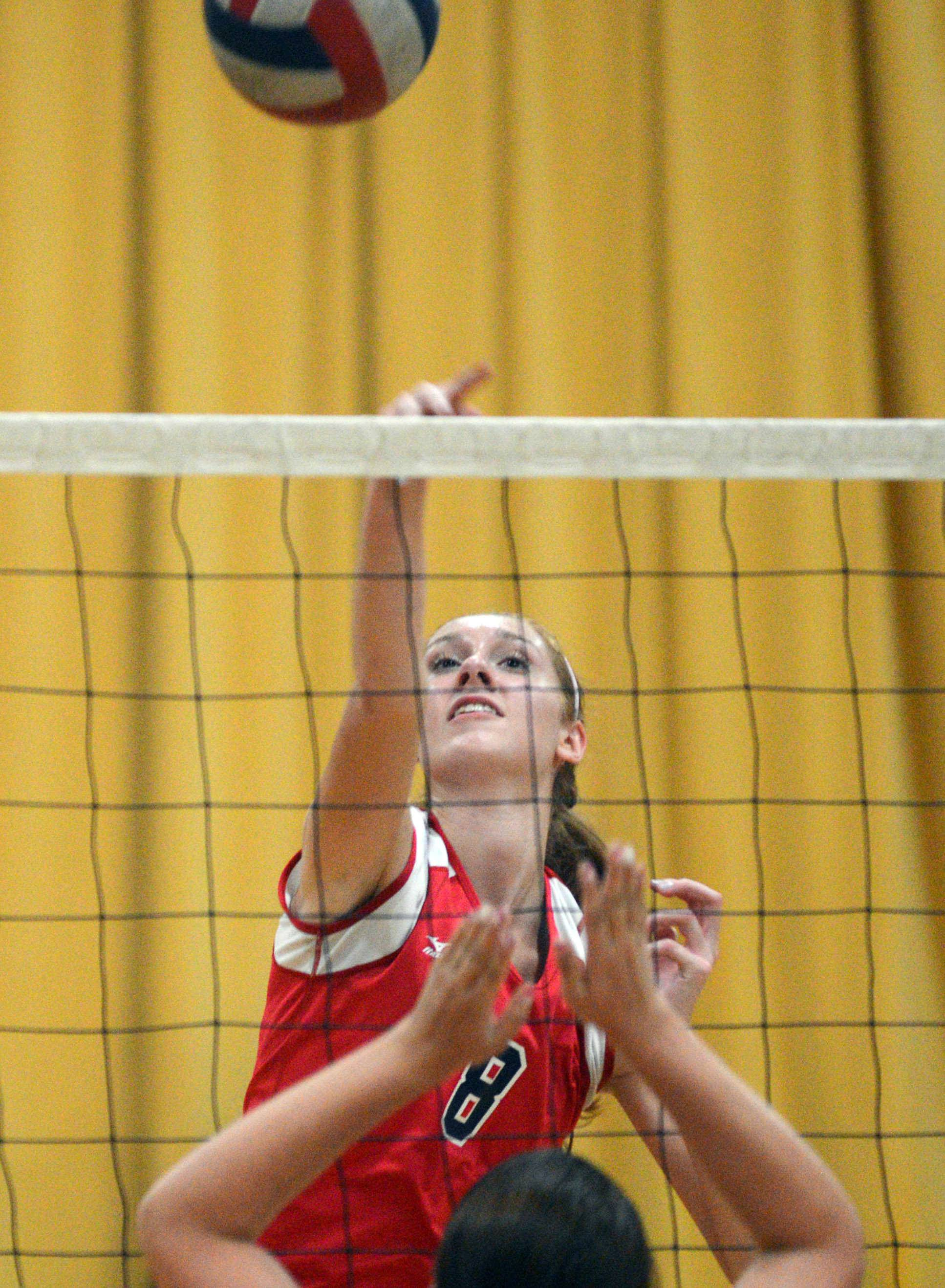 South Elgin's Sarah Hallas hits the ball   during volleyball at St. Edward on Wednesday evening.