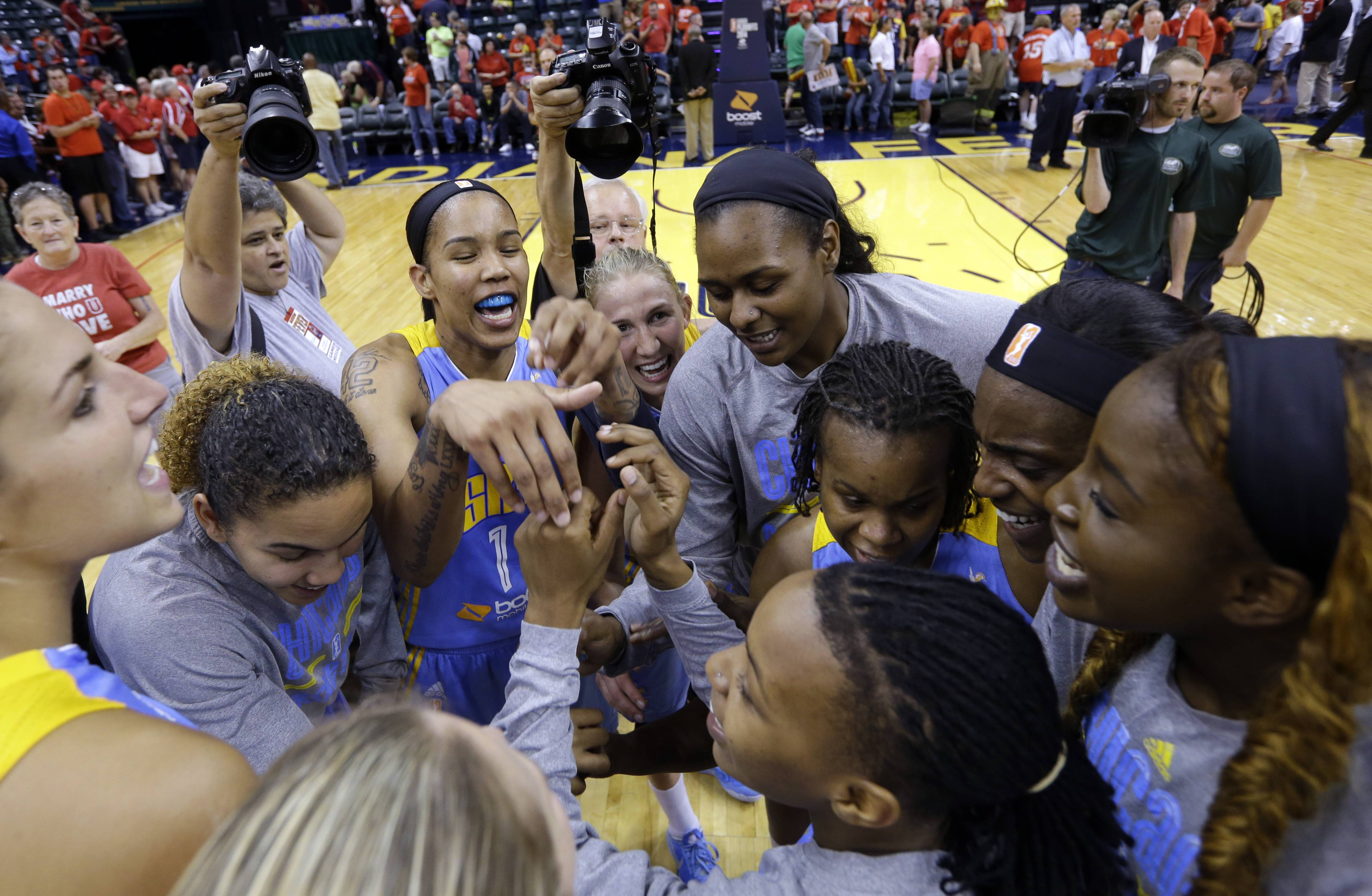 The Chicago Sky celebrates after defeating the Indiana Fever 75-62 in Game 3 of the WNBA Eastern Conference basketball finals Wednesday in Indianapolis. The Sky to advance to the WNBA Finals.