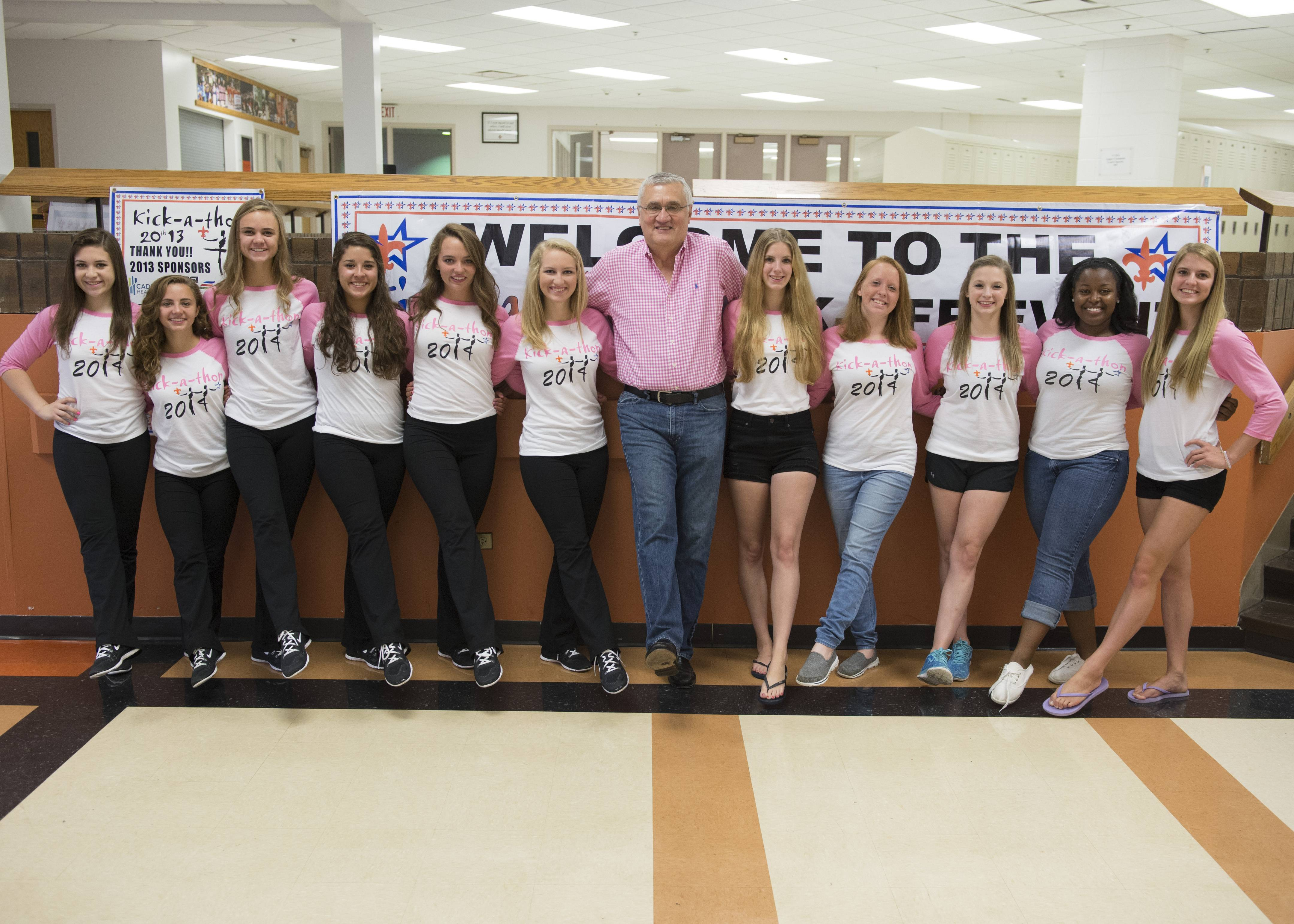 St. Charles Mayor Raymond Rogina joins with St. Charles senior drill team members: Katie Schmidt, Elisabeth Grenfell, MacKenzie Craney, Bella Reyes, Maggie Sullivan, Mallory Cook, Sina Hermes, Bailey Moberly, Isabel Miller, Eleisee Pettigrew and Quinn Samanic.