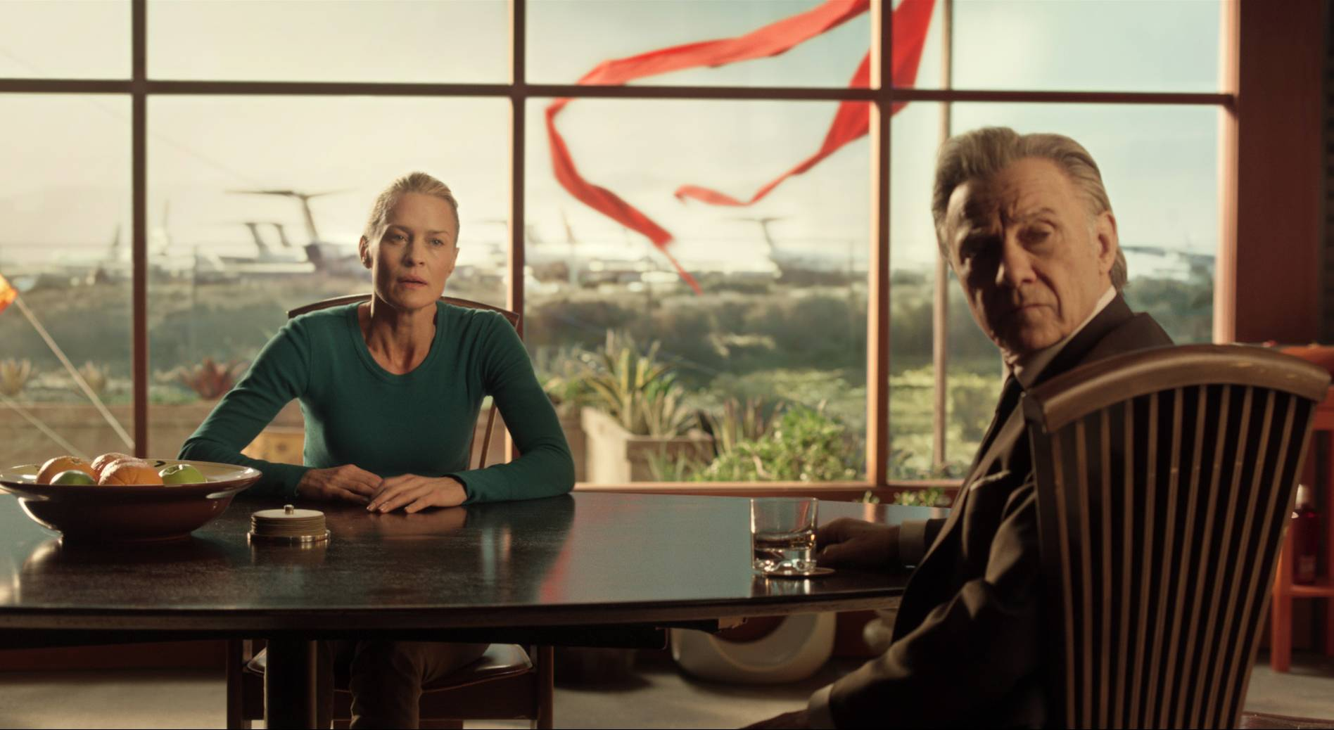 "Robin Wright (playing a version of herself) meets with her agent (Harvey Keitel) in ""The Congress."""