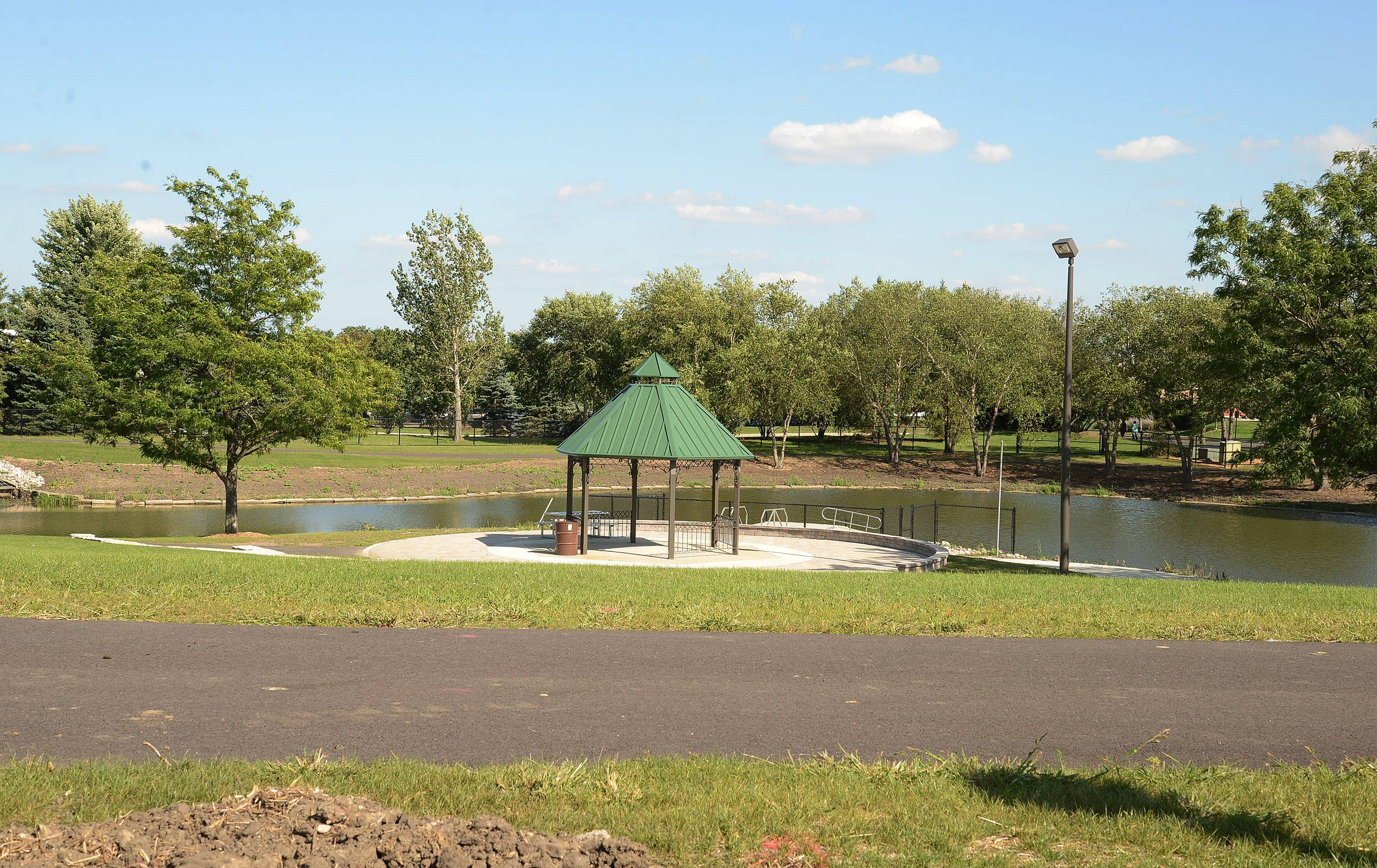 The Schaumburg Park District's new dog park, scheduled to open Oct. 1, has inspired the concern of a nearby Hoffman Estates resident over the safety of its water feature for both pets and people. The pond will be encircled by a fence before opening day.