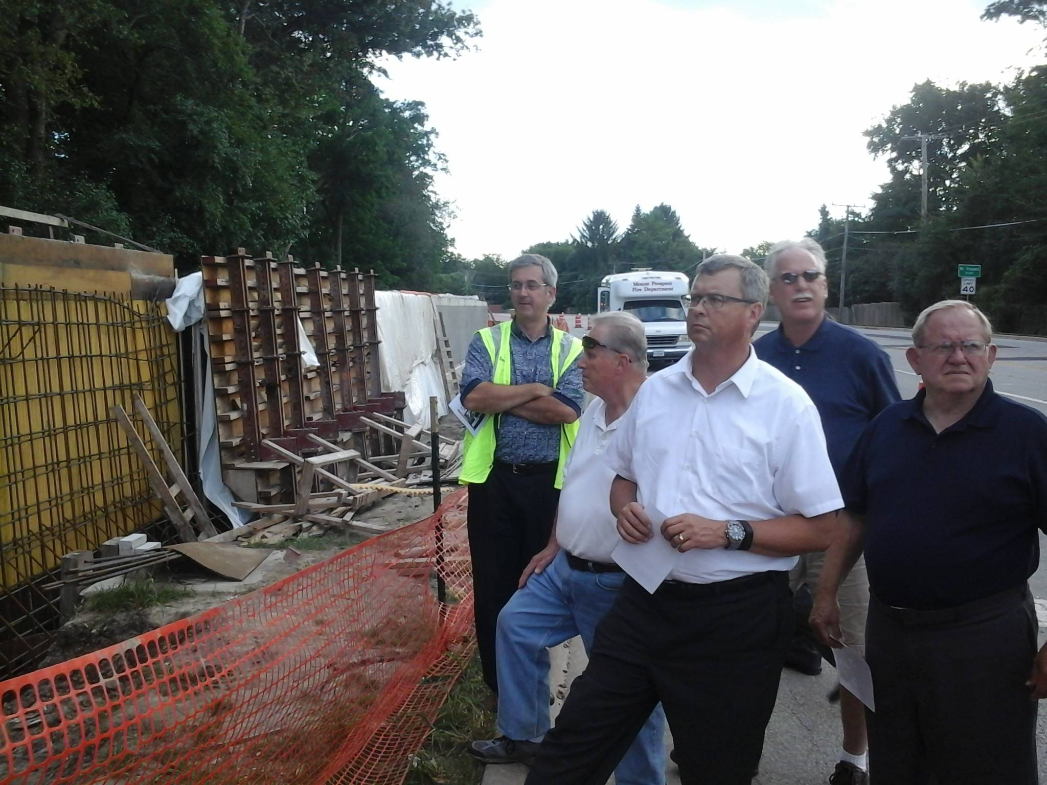 From left, Assistant Village Manager David Strahl, Trustee A. John Korn, Trustee John Matuszak, Trustee Steven Polit and Trustee Richard Rogers view Levee 37 flood prevention work in Prospect Heights.