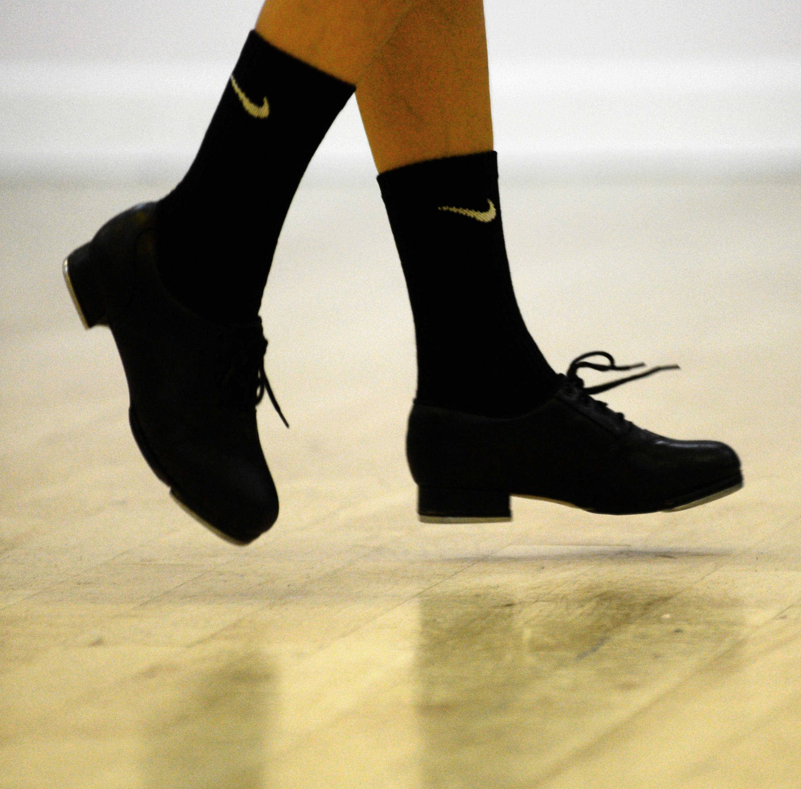 Brianne Cannataro, 10, of Schaumburg practices tap dancing at The Edge Dance Academy in Palatine. Brianne, who's also a straight-A student, is one of just three dancers chosen to represent the United States in December at the World Tap Dance Championship.