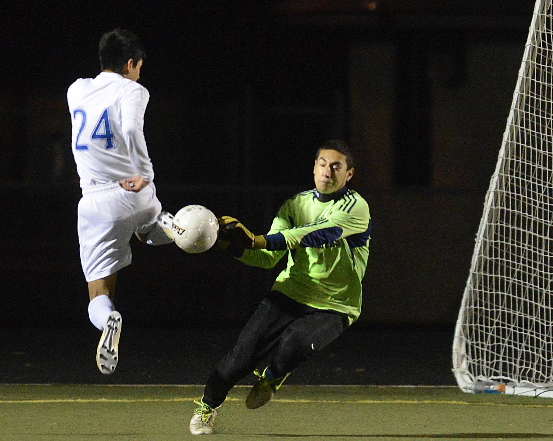 Larkin's Alex Cruz is unable to get the ball past Dundee-Crown goalkeeper Jose Gonzalez in regional play last season at Millennium Field in Streamwood.