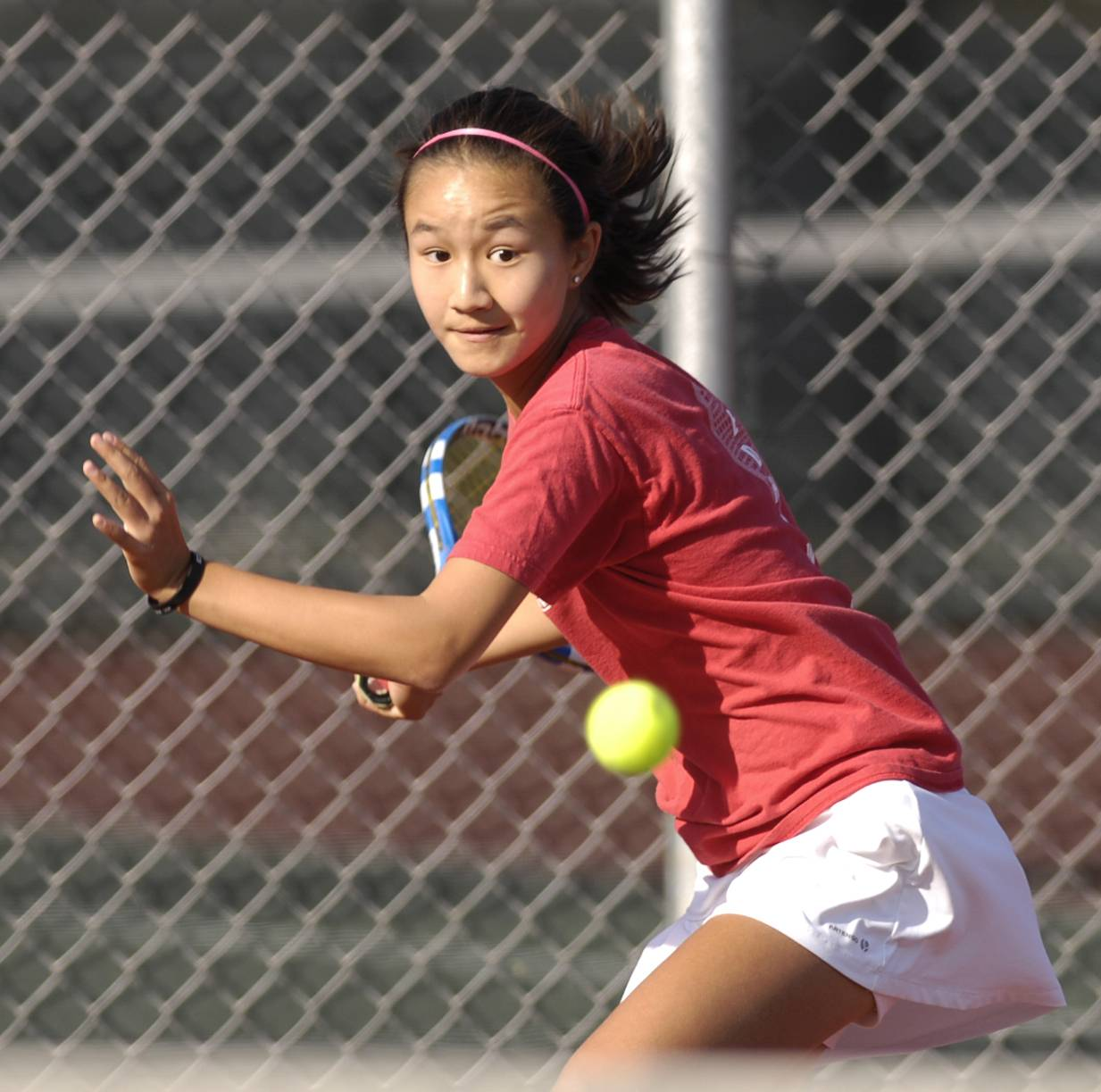 Tiffany Chen of Naperville Central plays against Anusha Pai of Neuqua Valley in girls varsity tennis, Wednesday.