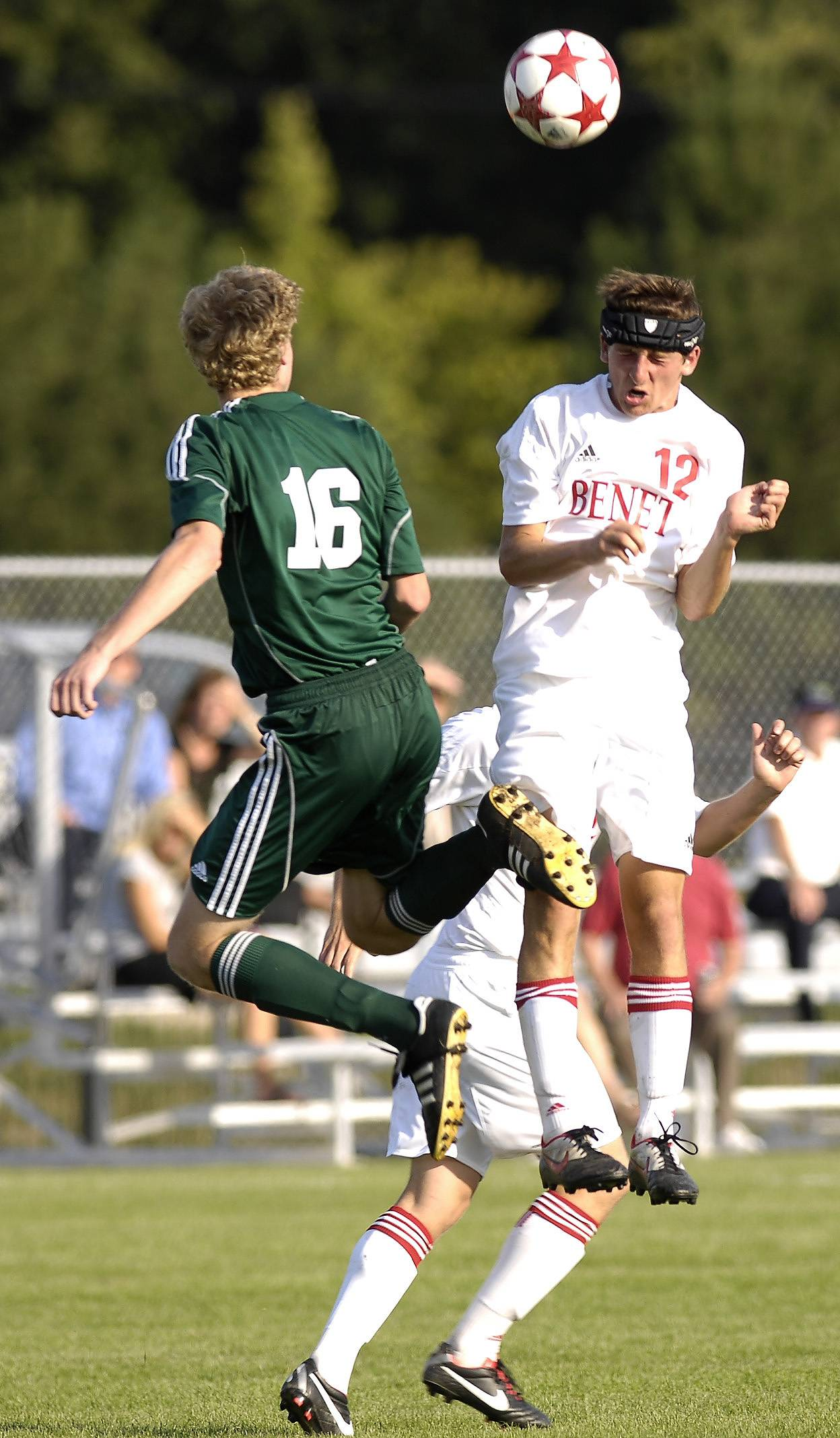 Mark Black/mblack@dailyherald.com ¬ Jack Cordes of Waubonsie Valley and Kyle Kenagy of Benet work for control of the ball during in boy soccer action in Lisle, Thursday.