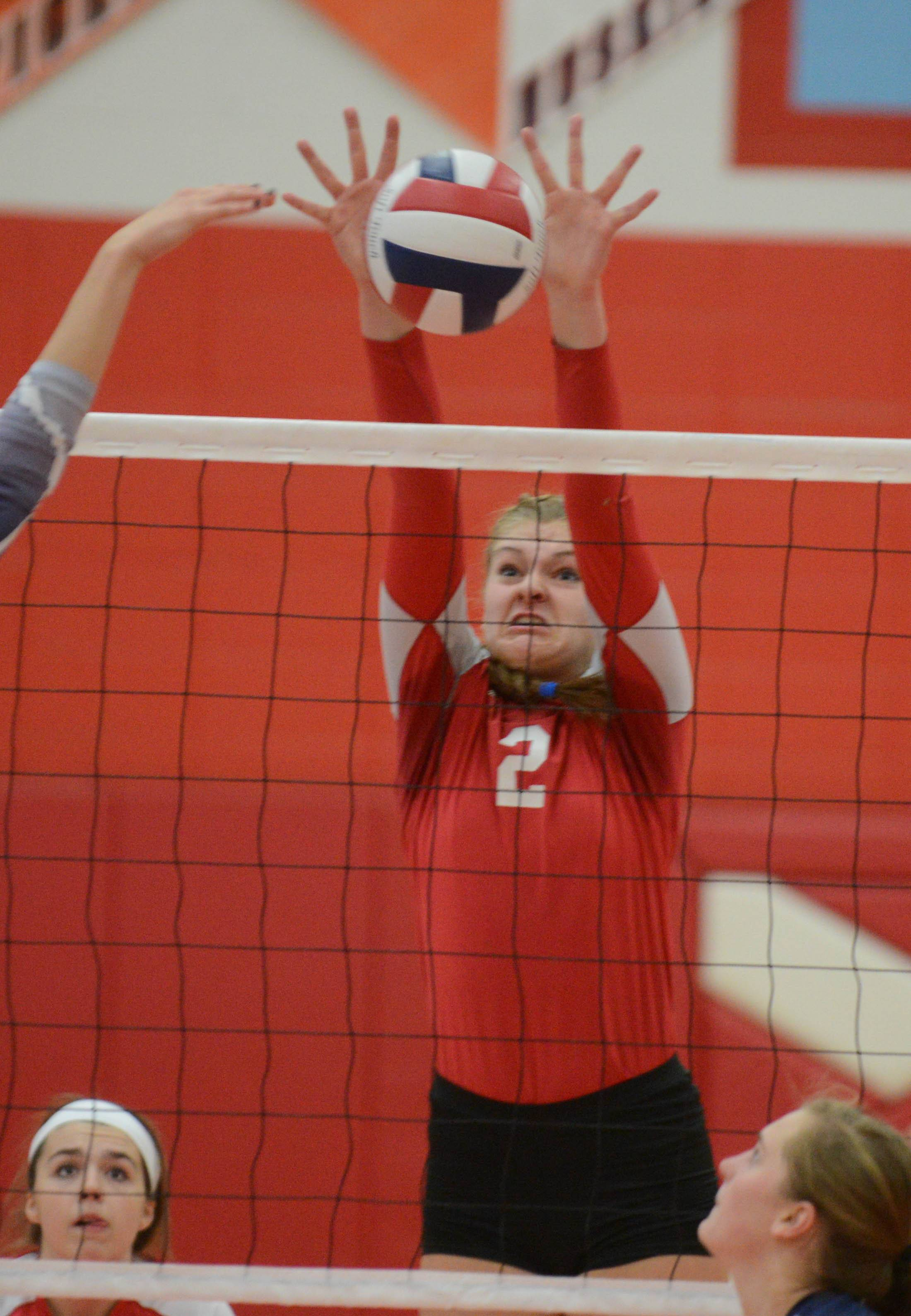 Paul Michna/pmichna@dailyherald.com ¬ Phoebe Havenaar of Naperville Central goes up for a block during the Naperville North at Naperville Central girls volleyball gameThursday.