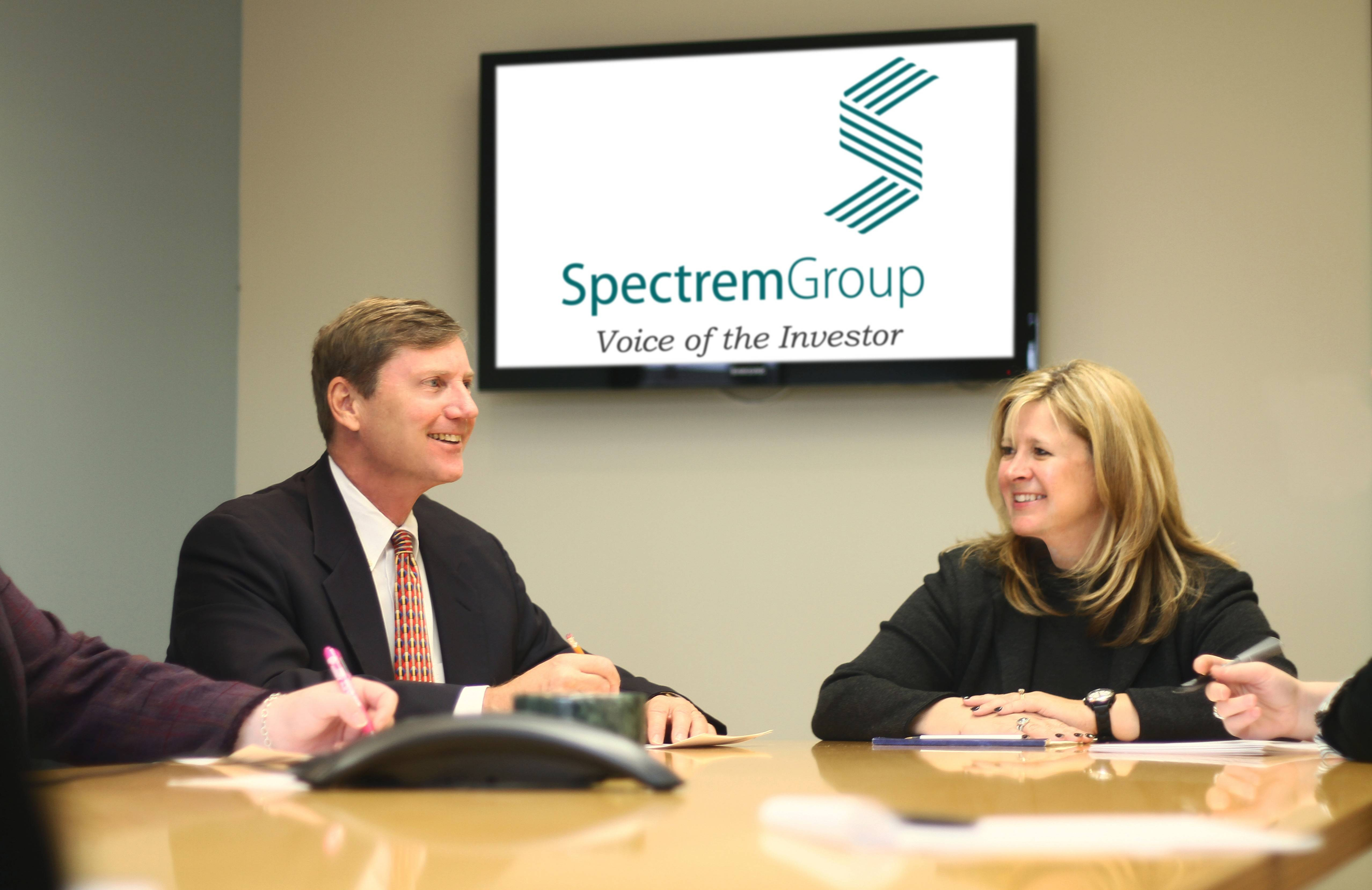 Spectrem Group President George H. Walper Jr., left and Managing Director Cathy McBreen during a meeting at the Lake Forest office.