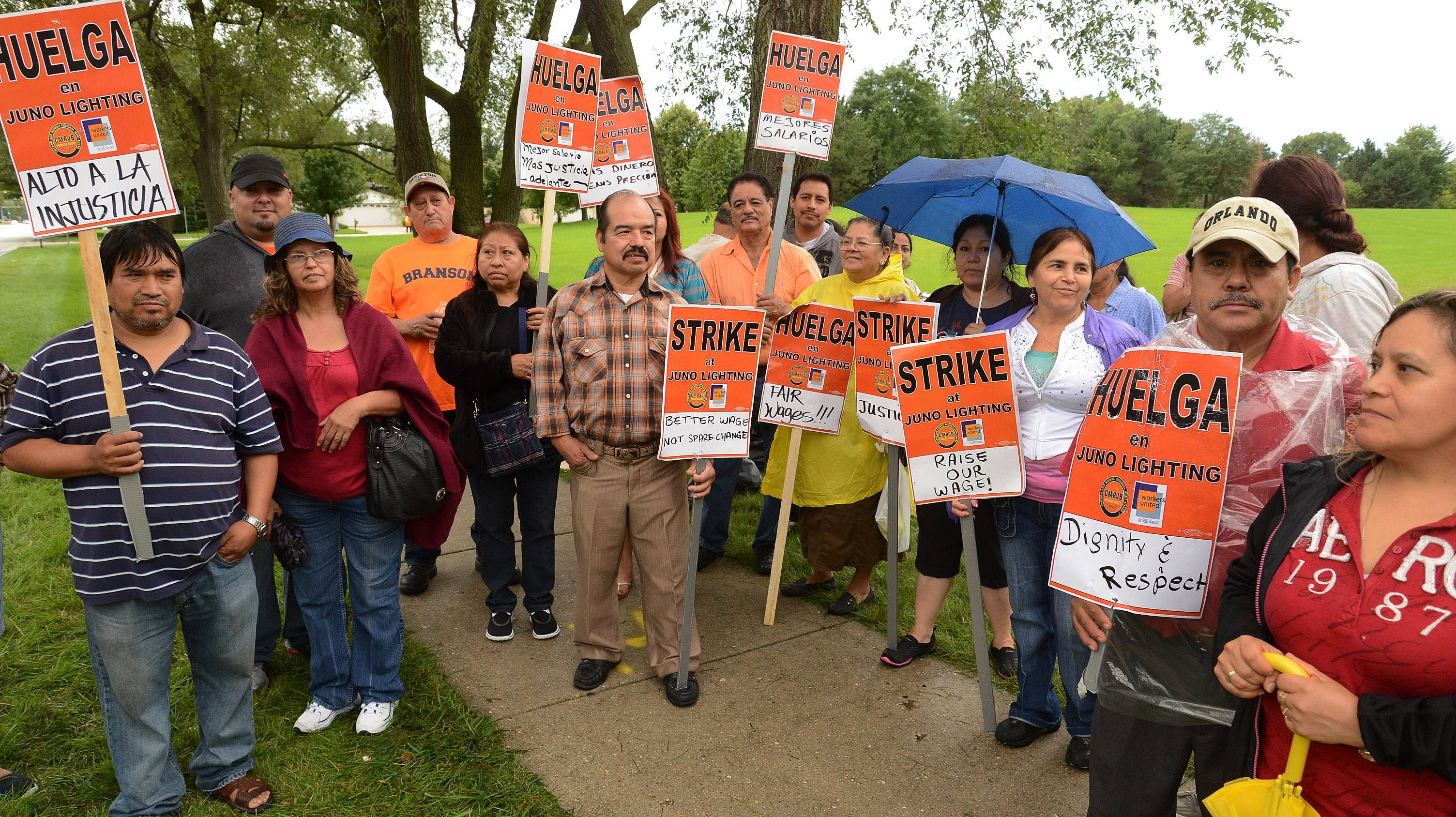 A group of workers at Juno Lighting Group in Des Plaines continued their strike Thursday, in protest of what they say are meager wage increases being offered by the company.