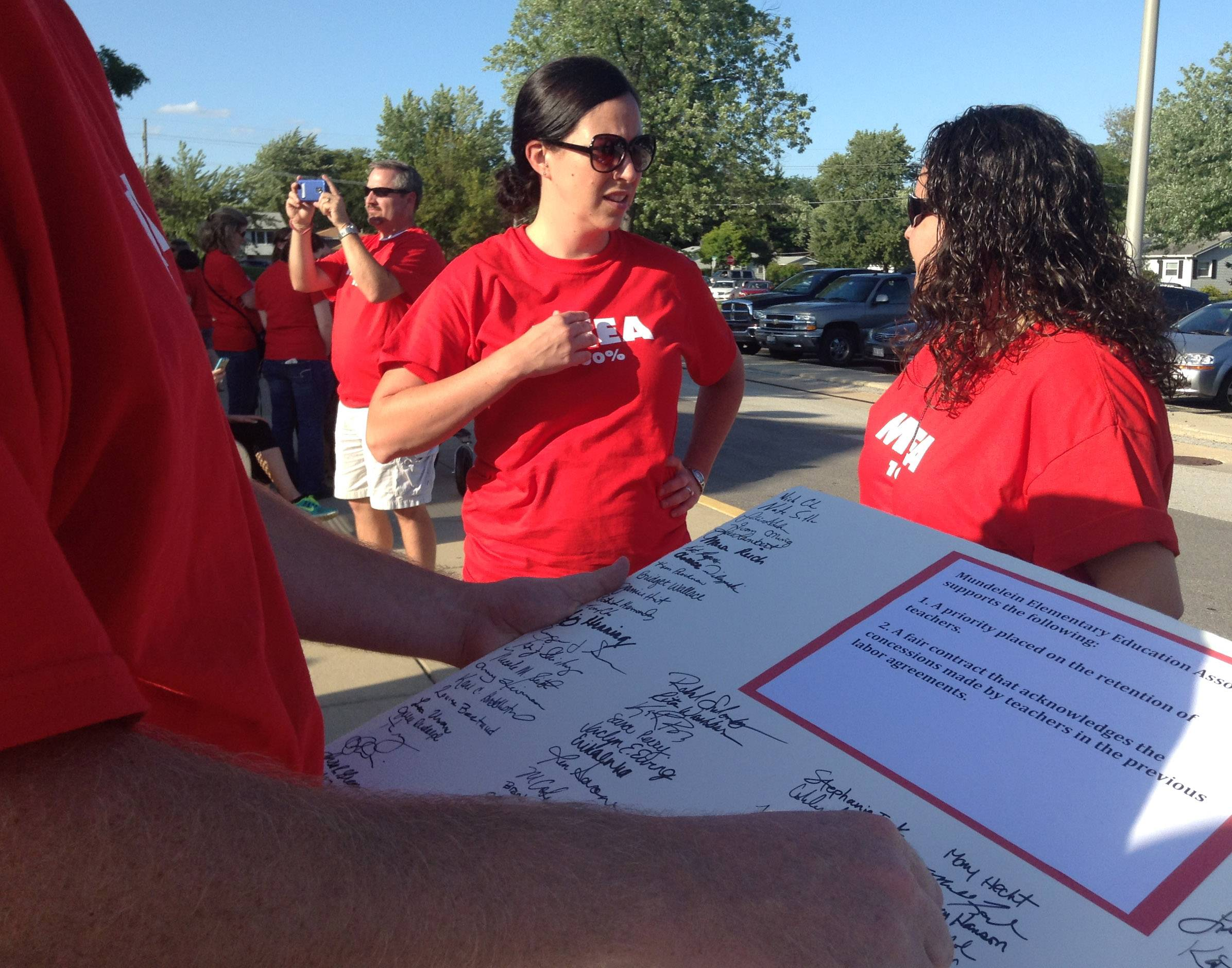 Mundelein Elementary District 75 teachers and supporters who rallied Wednesday evening presented district officials with a petition citing teacher retention and a fair contract as priorities.