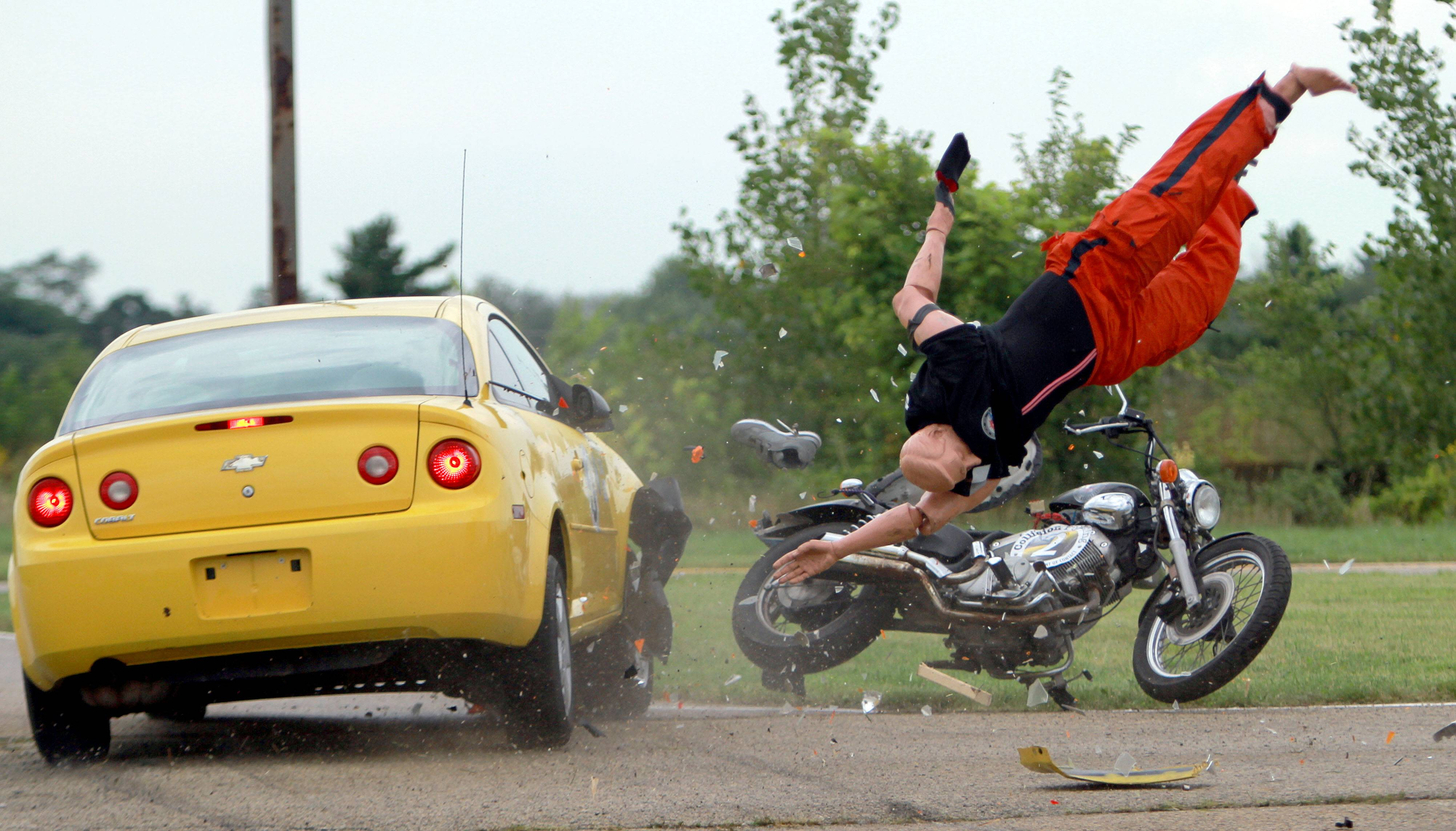 A trained crash driver and a mannequin on a motorcycle stage a crash test Thursday as part of a training exercise for the Major Crash Assistance Team of Lake County at the former Lake County fairgrounds in Grayslake. Police from throughout the suburbs participated.