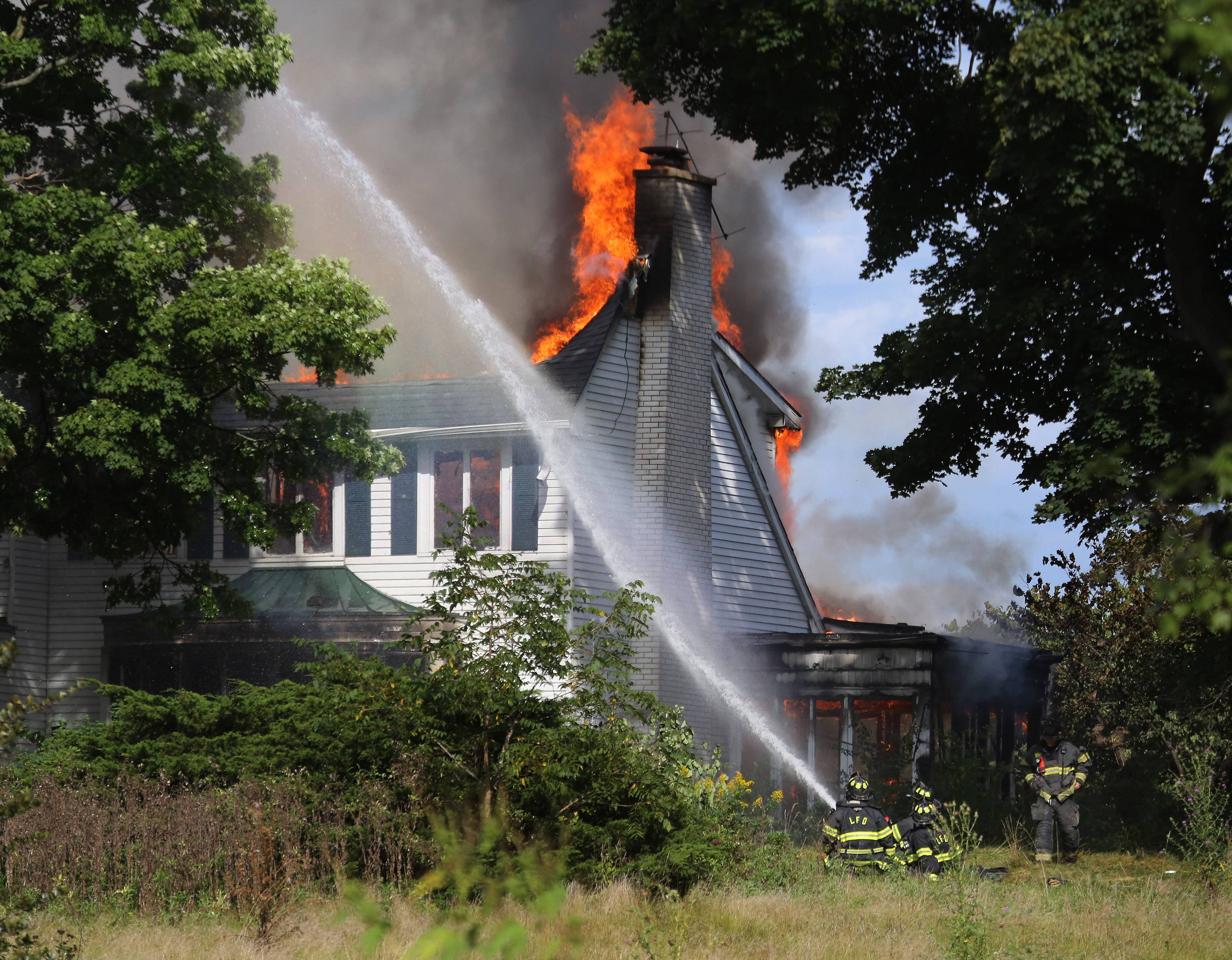 The Lake County Forest Preserve District's former headquarters along Milwaukee Avenue in Libertyville was engulfed in flames Thursday. Firefighters from Libertyville, Mundelein, Gurnee, Countryside, Lake Forest, Lake Villa, Round Lake and others battled the blaze throughout the afternoon.