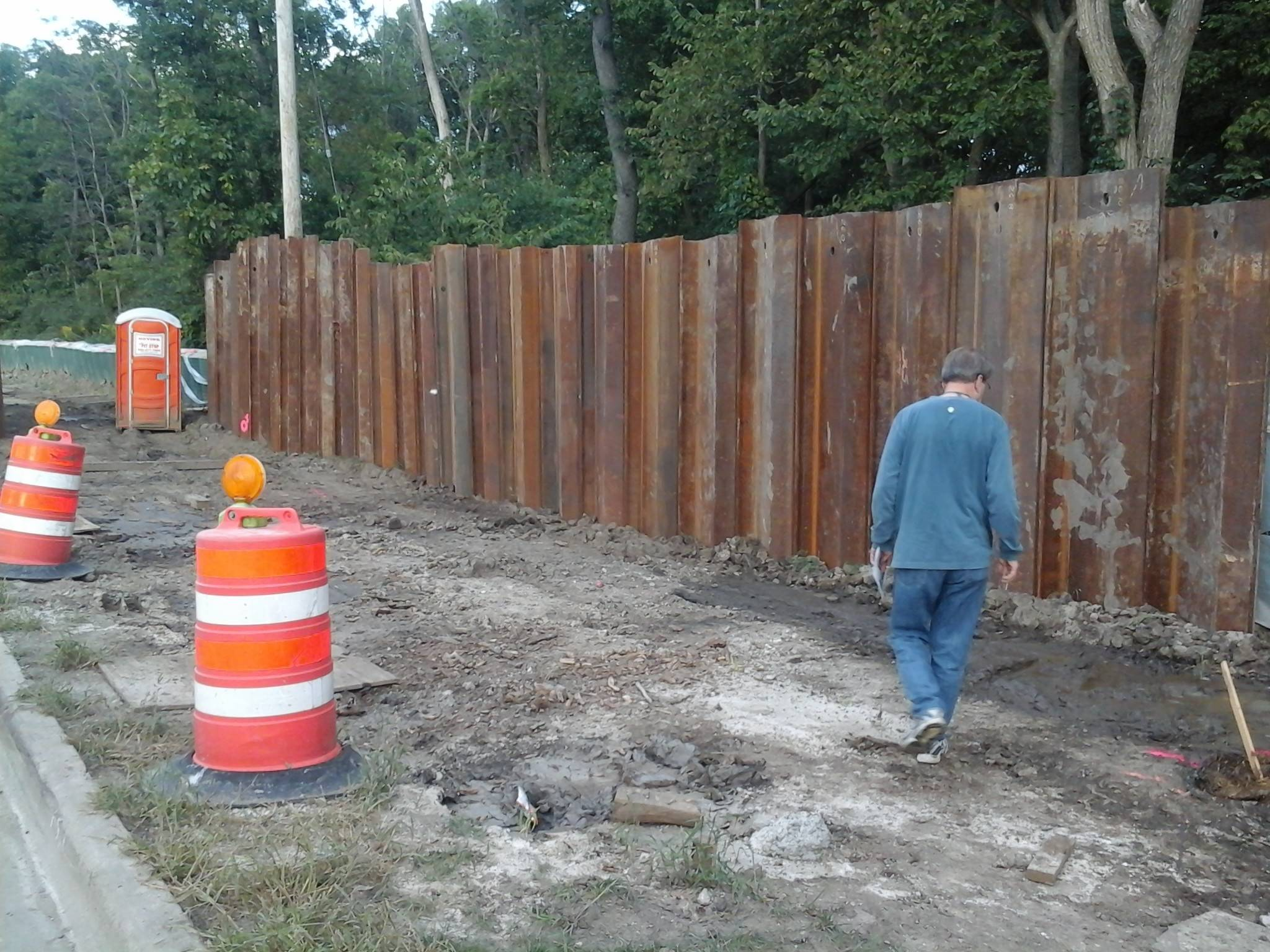 Trustee Paul Hoefert examines the progress of filling the 600-foot gap in the Levee 37 barrier along Des Plaines River Road in Prospect Heights. Work on the barrier should be completed by the end of the year.
