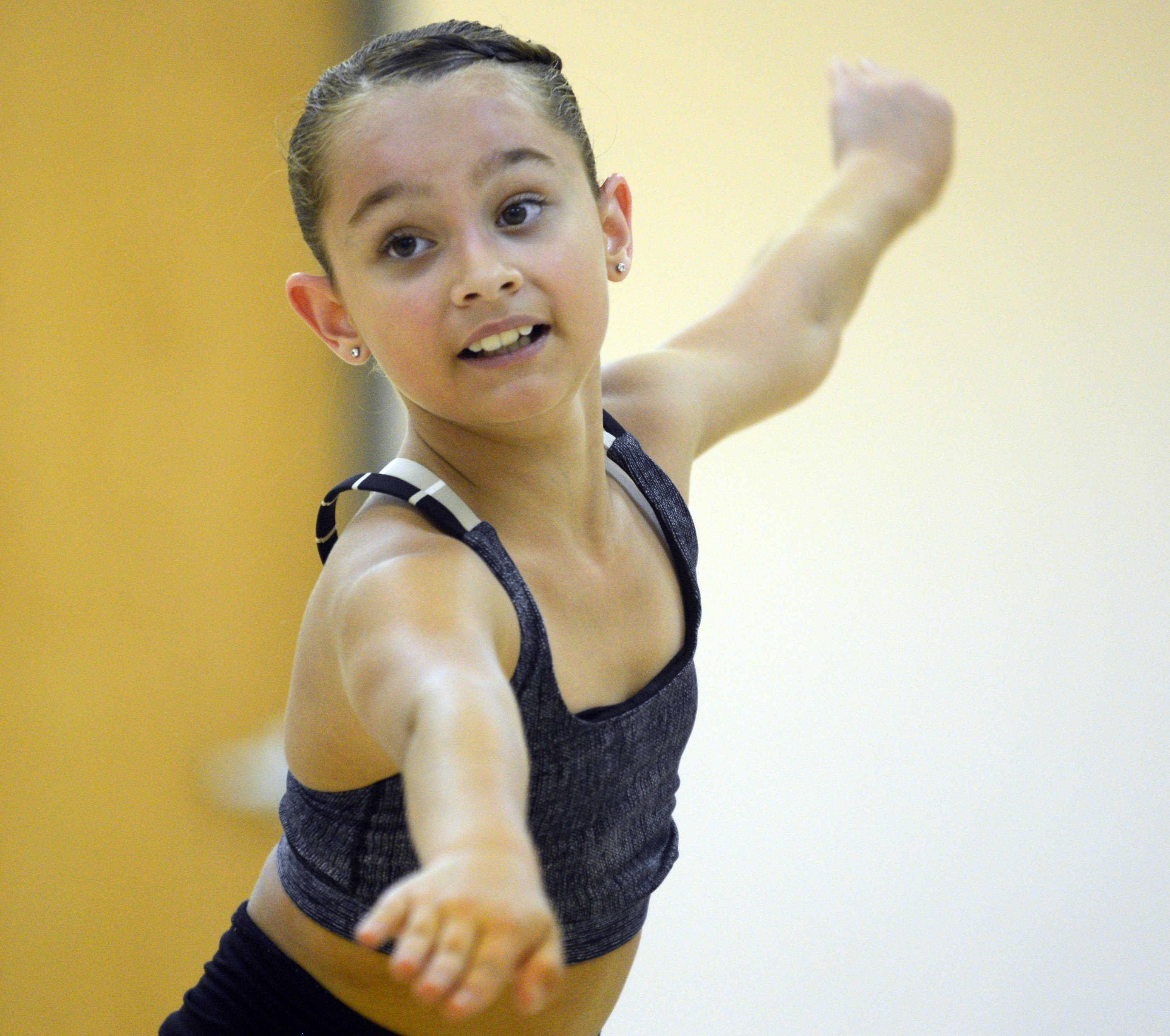 Brianne Cannataro of Schaumburg practices tap dancing at The Edge Dance Academy in Palatine. The 10-year-old from Schaumburg not only is among the best tap dancers in her age group in the country, but she's also a straight-A student at Buzz Aldrin Elementary School.