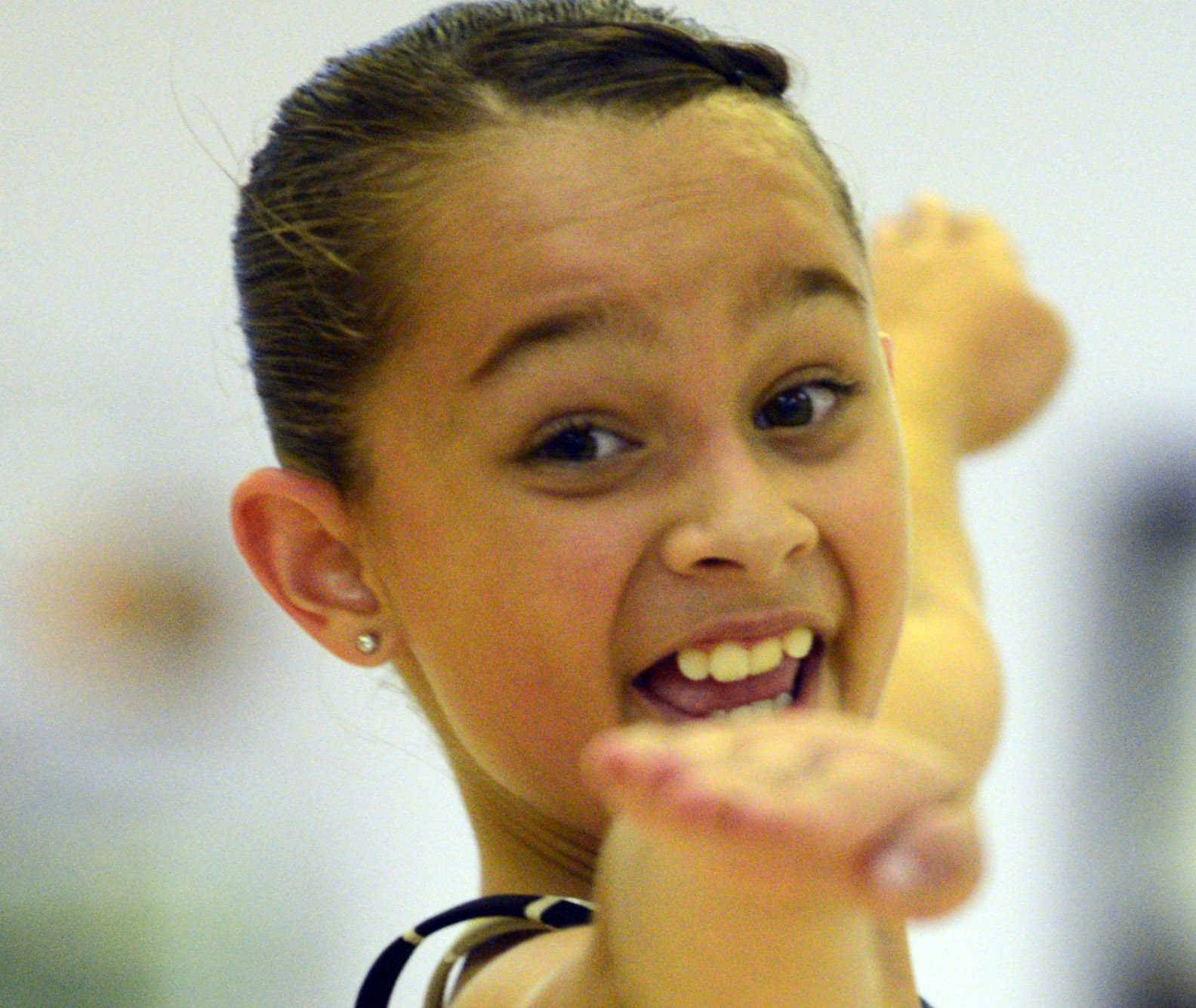 Brianne Cannataro, 10, practices one of her tap-dancing routines at The Edge Dance Academy in Palatine. The Schaumburg girl is one of just three dancers chosen to represent the United States at the World Tap Dance Championship, to be held later this year in Germany.