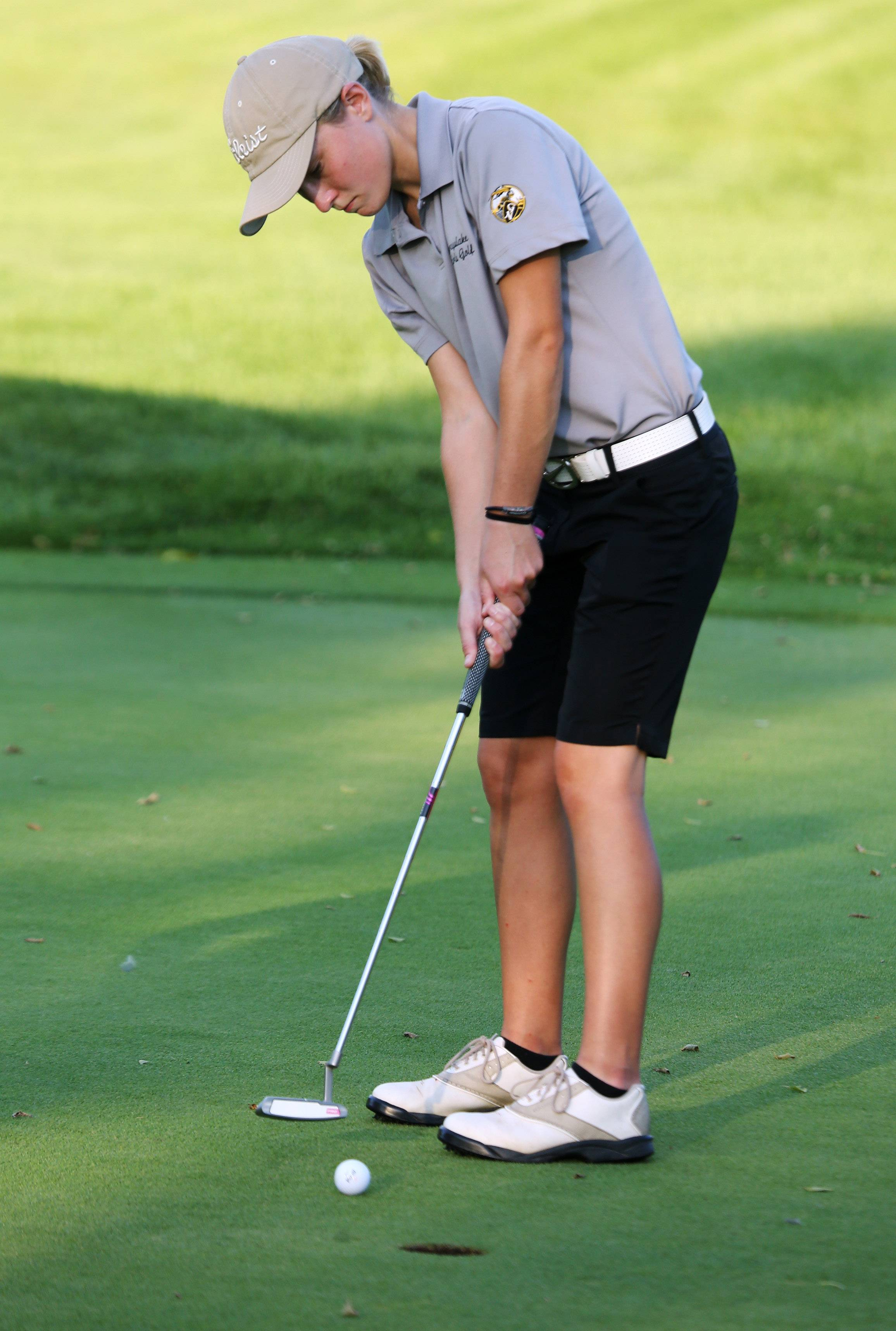 Grayslake golfer Ireland Dunne puts on the 10th hole during the high school girls golf match between Grayslake and Marengo on Thursday at Brae Loch Golf Course in Grayslake.