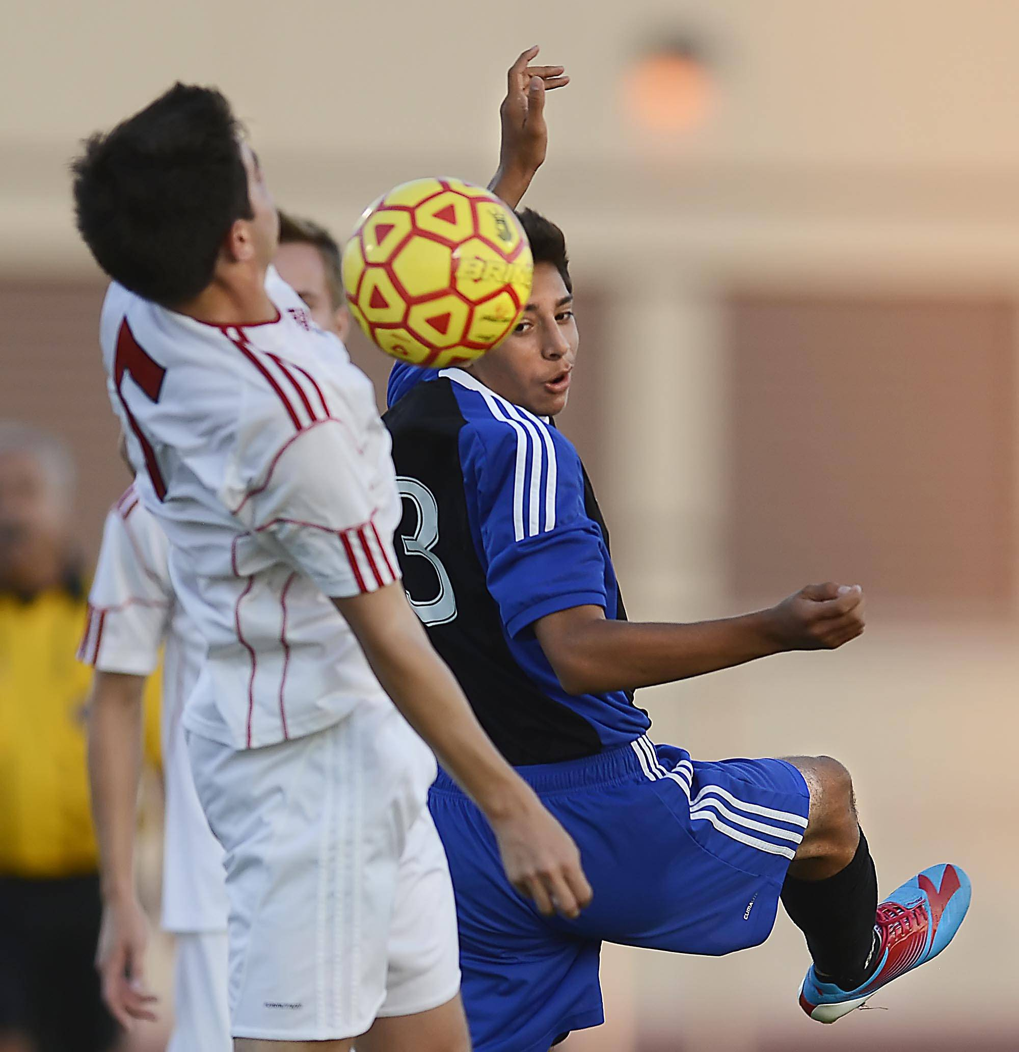 Larkin's Juan Reyes turns as he battles for the ball with Batavia's Daniel Zagoren Thursday in Batavia.