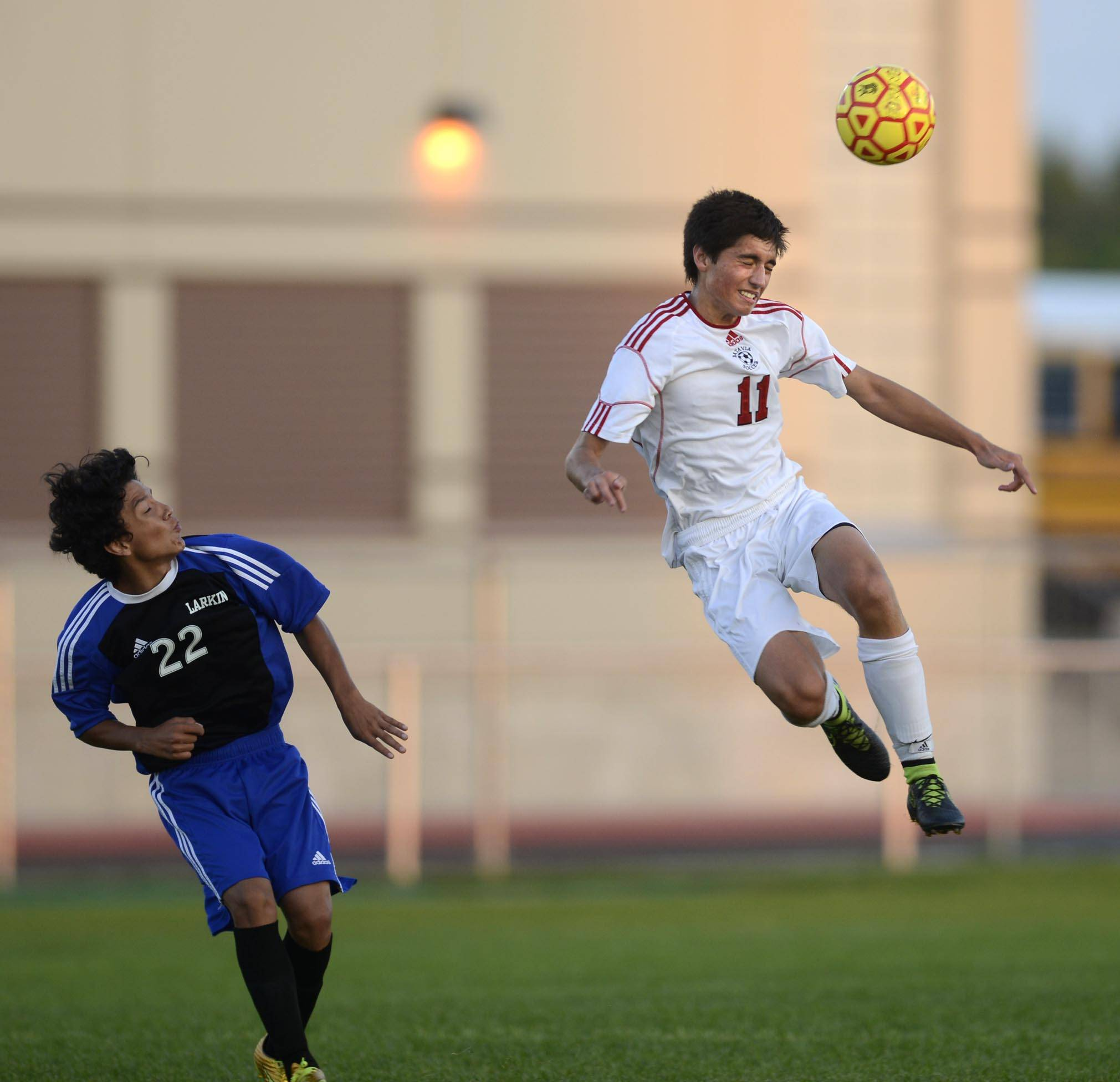 Batavia's Luke Laurich jumps to take a header in front of Larkin's Sammy Rodriguez Thursday in Batavia.