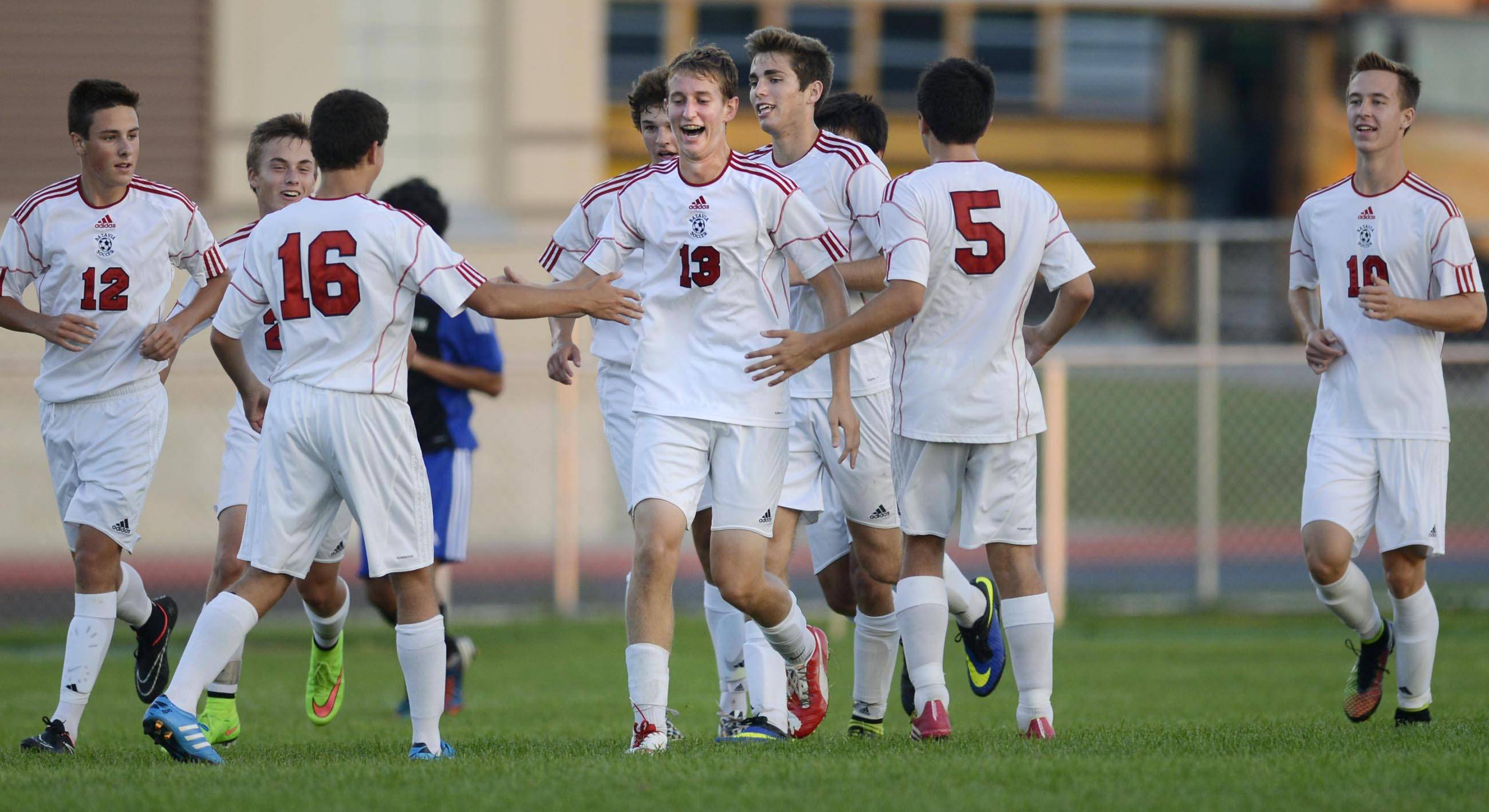 Batavia's Nick Konopacki is surrounded by teammates after his first half goal against Larkin Thursday in Batavia.