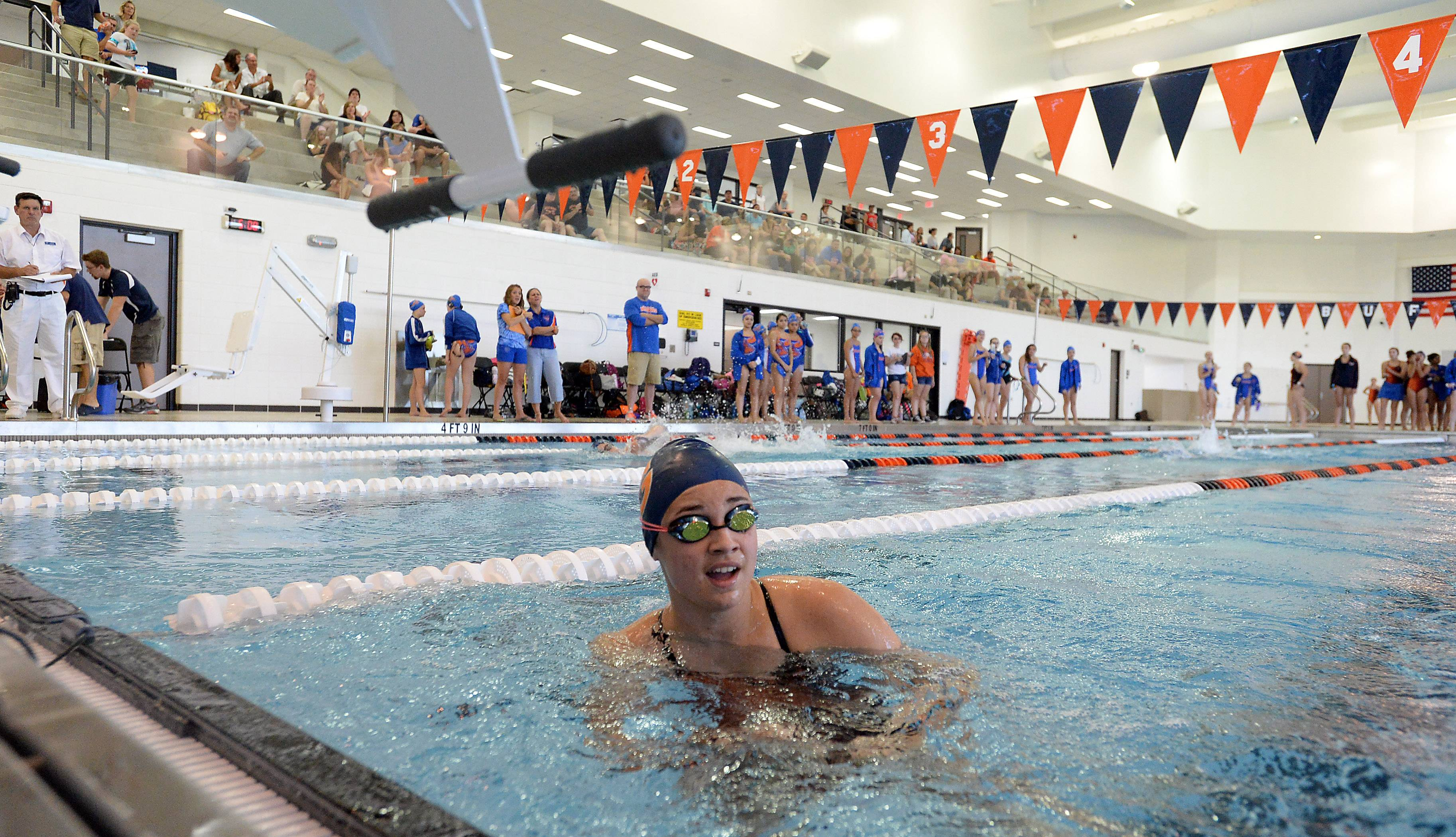 Sarah Morosan of Buffalo Grove checks out her winning time in the 50-yard freestyle during the first varsity meet held in Buffalo Grove's new pool Thursday.